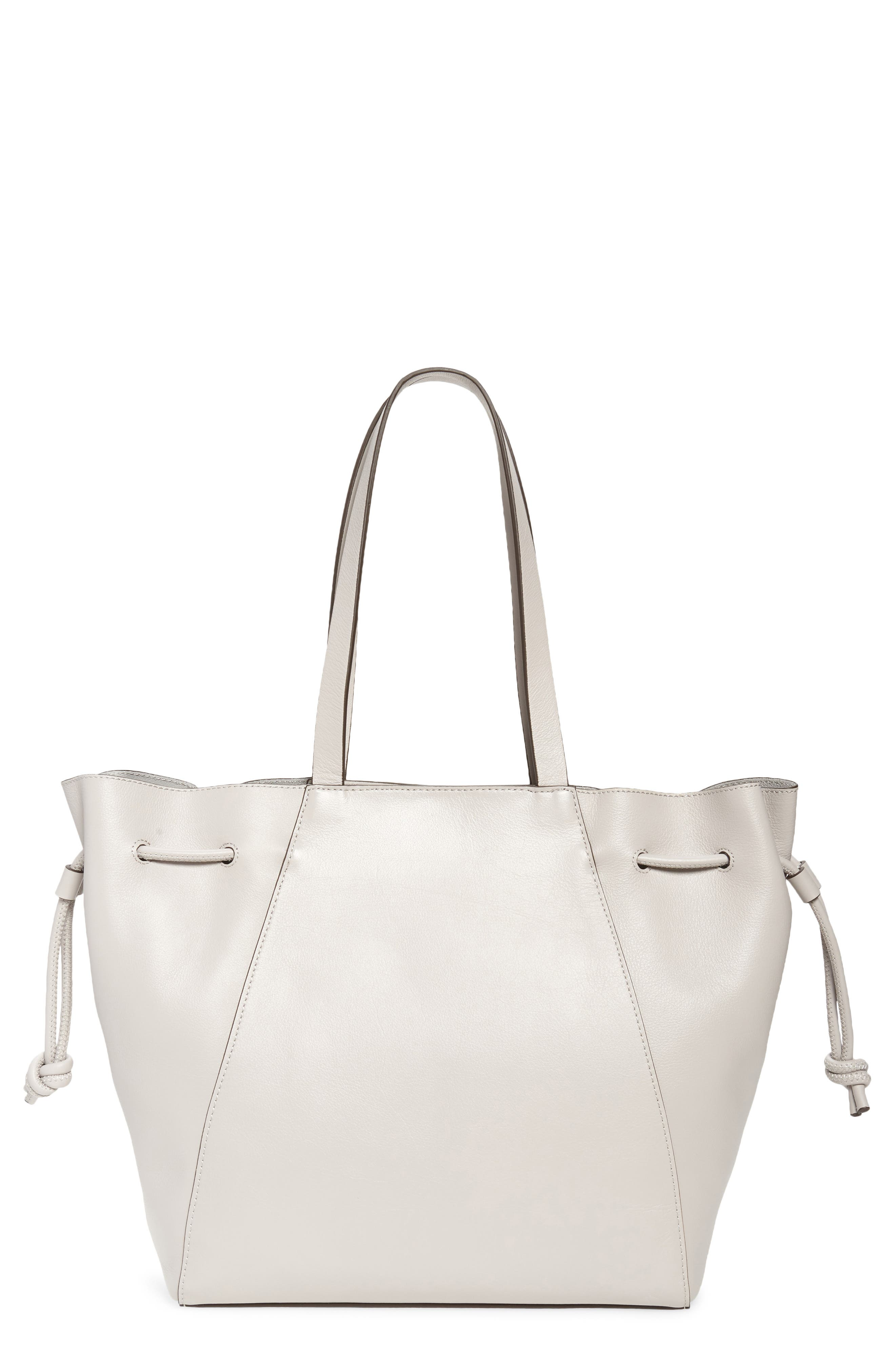 A knotted drawstring cinching the trapezoidal silhouette brings striking detail to a spacious carryall crafted from rich leather. When you buy Treasure & Bond, Nordstrom will donate 2.5% of net sales to organizations that work to empower youth. Style Name: Treasure & Bond Delaney Drawstring Leather Tote. Style Number: 5960321. Available in stores.