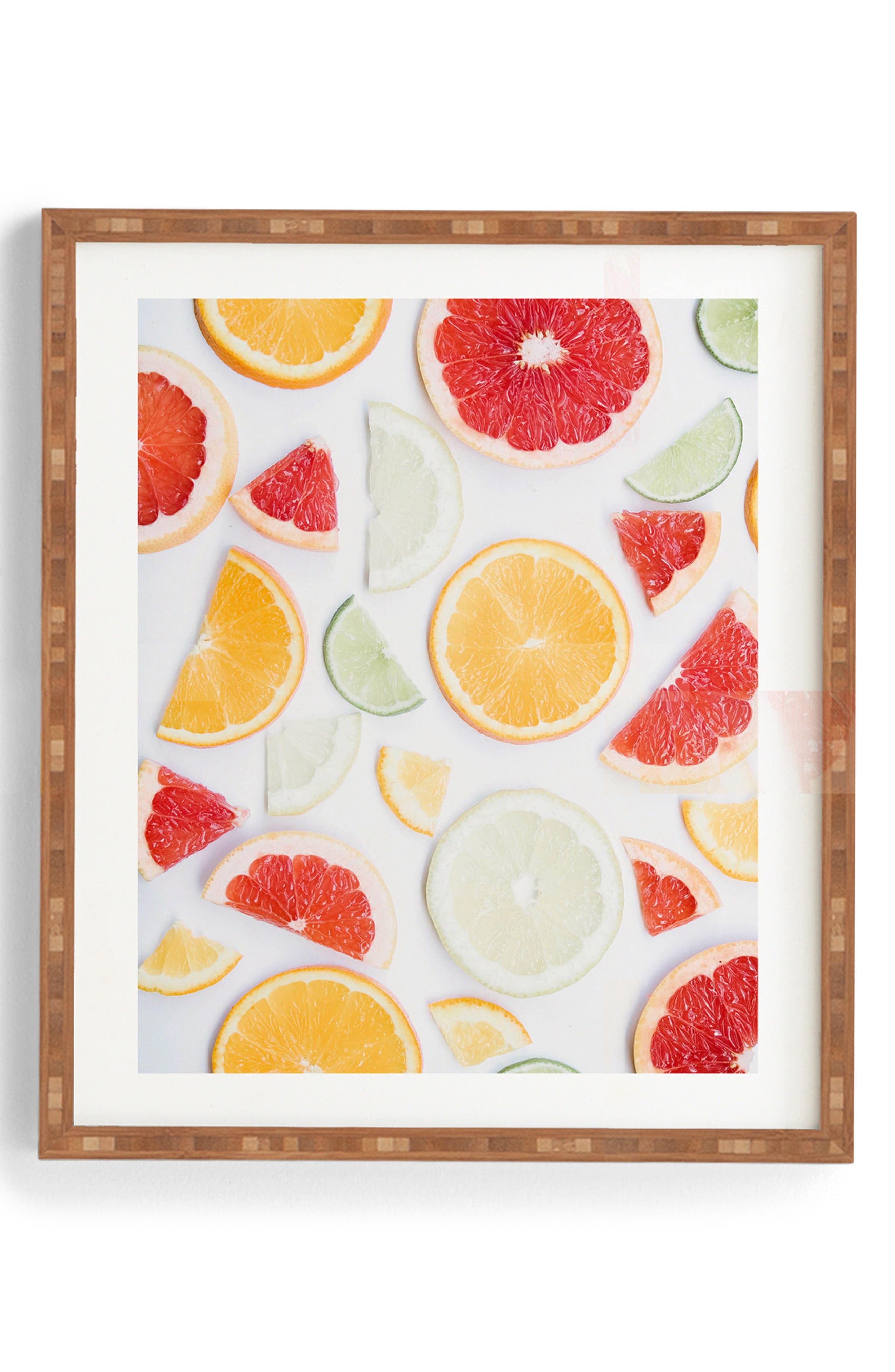 Juicy citrus slices captured by artist Ingrid Beddoes take center stage on ready-to-hang wall art featuring a satin finish and a rustic bamboo frame. Style Name: Deny Designs Citrus Fresh Framed Wall Art. Style Number: 5636429. Available in stores.