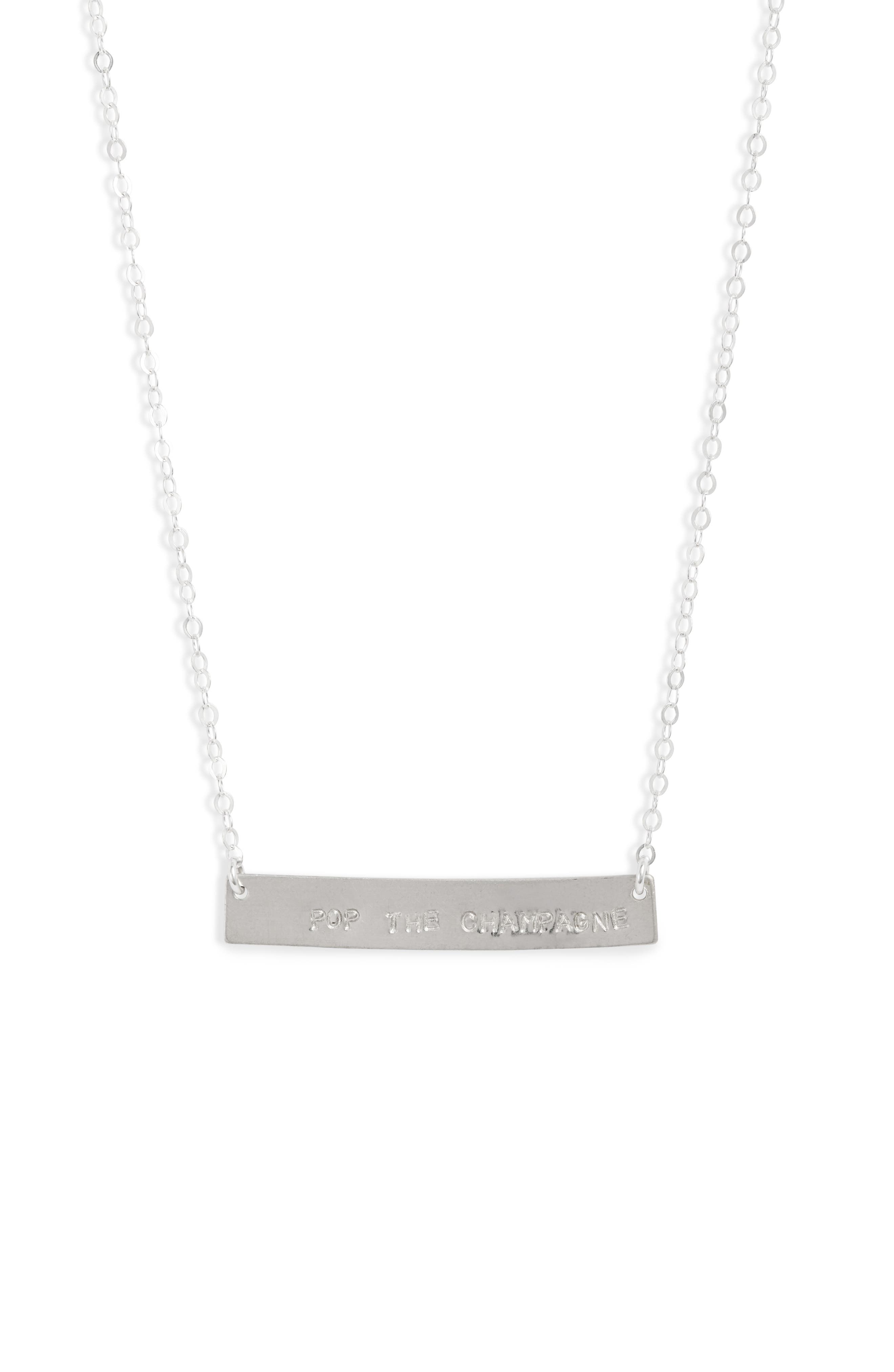Celebrate a promotion, engagement or just life itself with this bar pendant necklace that\\\'s hand stamped with the phrase, \\\'pop the champagne.\\\' Style Name: Set & Stones Cassie Pop The Champagne Bar Necklace. Style Number: 5966506. Available in stores.