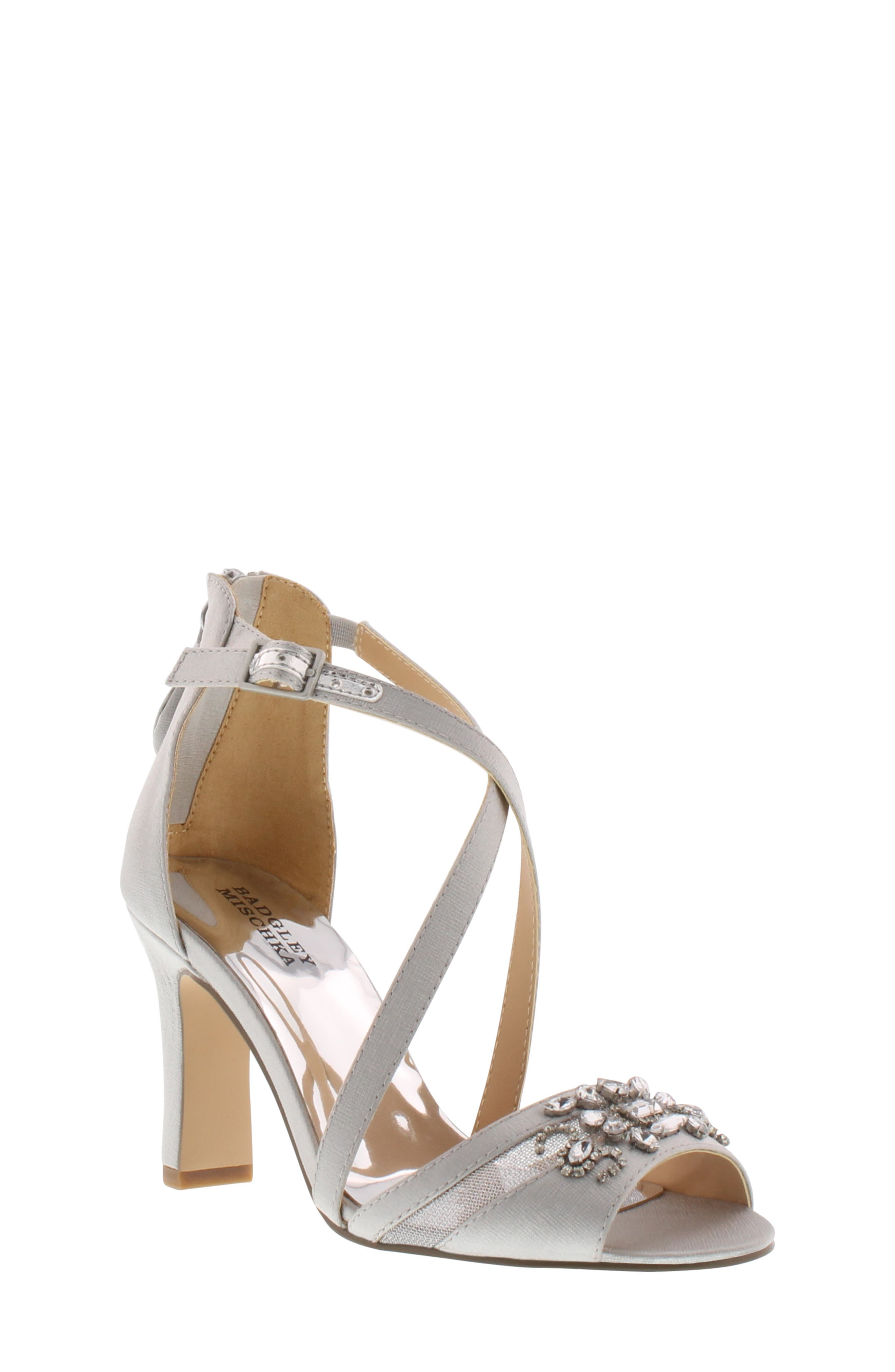Clusters of crystals add pretty sparkle to the shine of a black-satin sandal styled with slender straps crossing gracefully up the front and a half-moon heel adding lift. Style Name: Badgley Mischka Kandall Hannah Embellished Cross Strap Sandal (Little Kid & Big Kid). Style Number: 5425042. Available in stores.