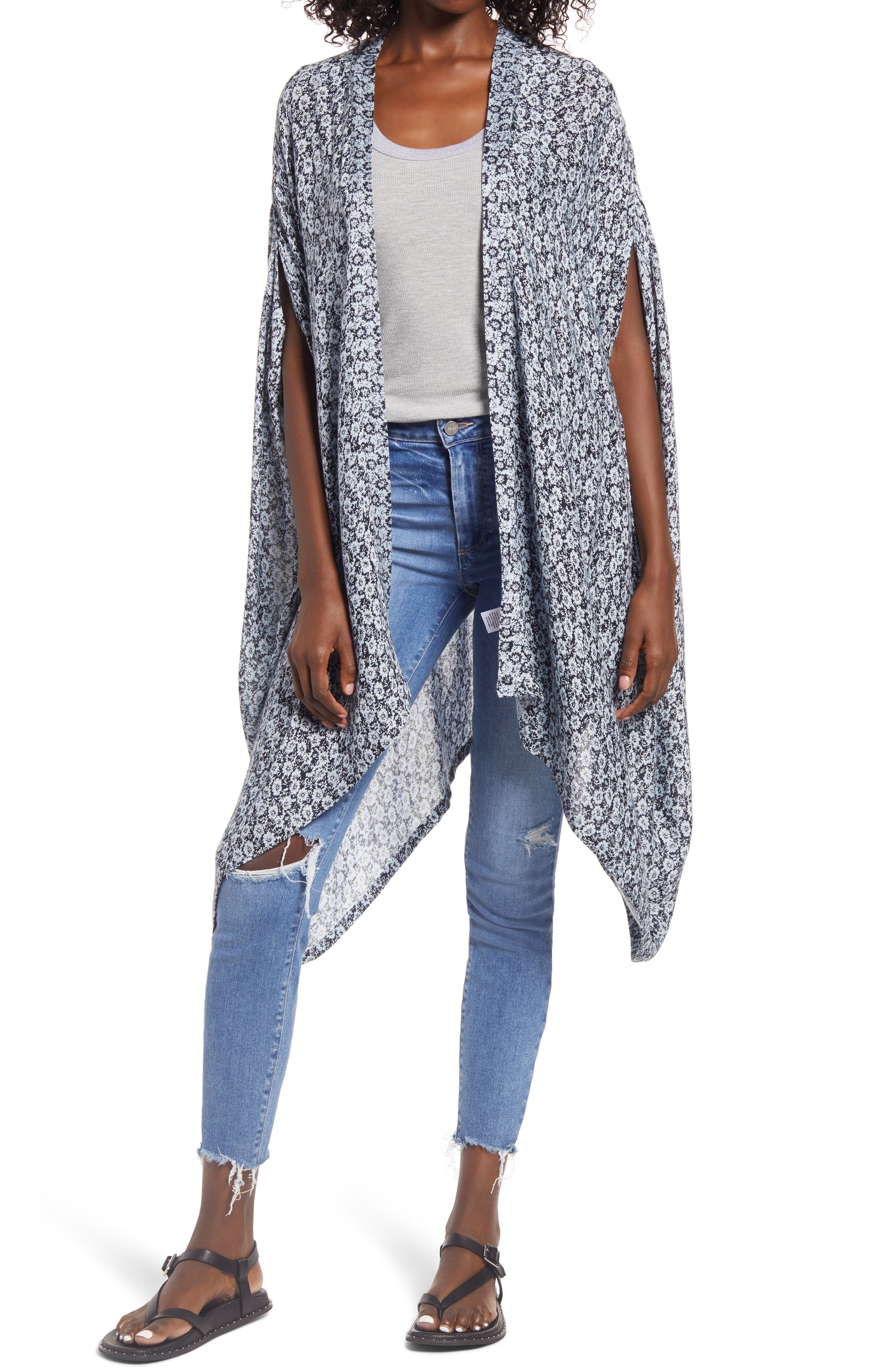 Cover up in this drapey, lightweight overlay styled with a versatile open front and a whimsical allover print. When you buy Treasure & Bond, Nordstrom will donate 2.5% of net sales to organizations that work to empower youth. Style Name: Treasure & Bond Oversize Print Ruana. Style Number: 6017716. Available in stores.