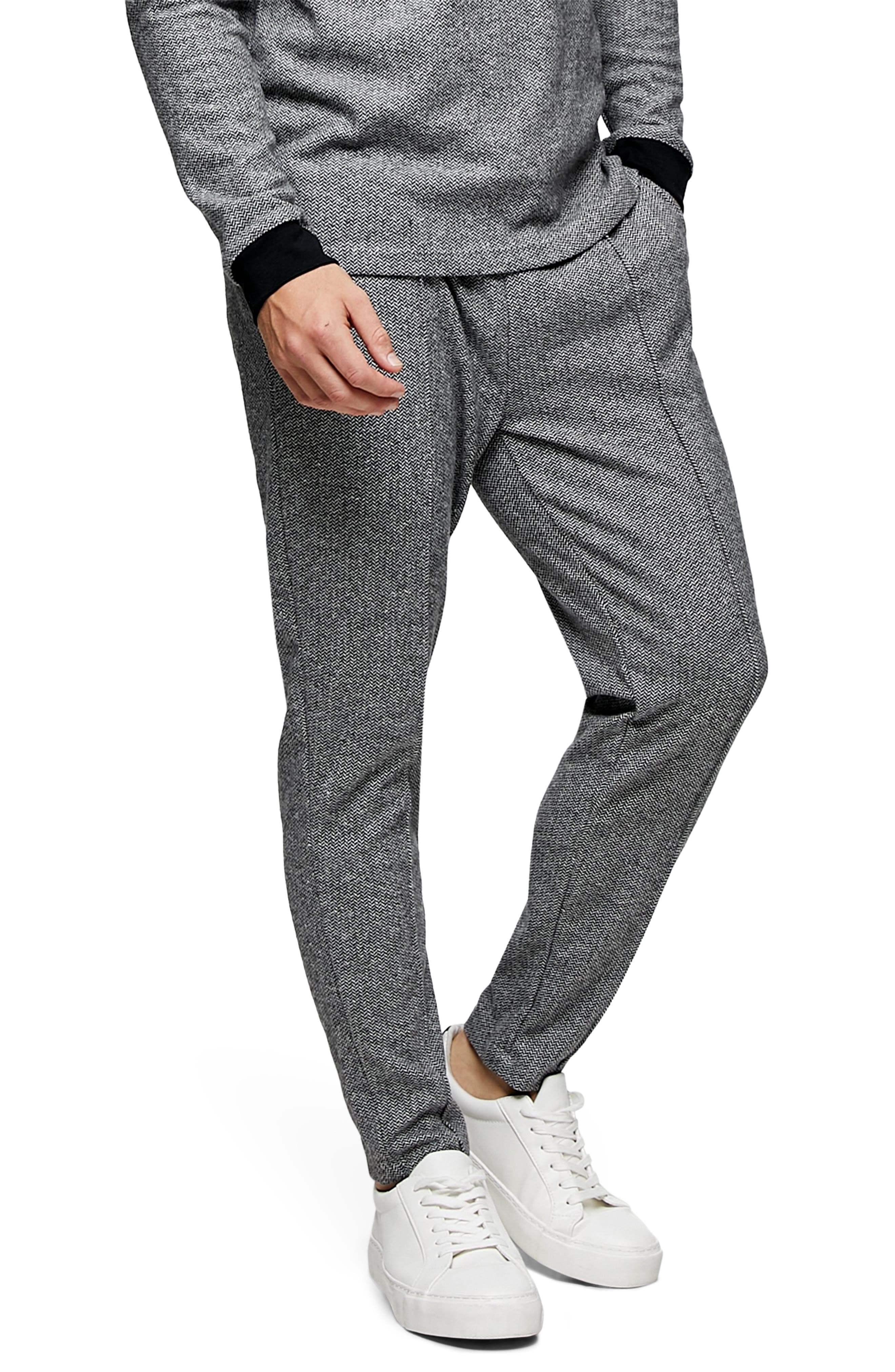 An athletics staple gets a serious upgrade with classic herringbone patterning and center seams that really sharpen the look. Style Name: Topman Herringbone Joggers. Style Number: 6138980. Available in stores.