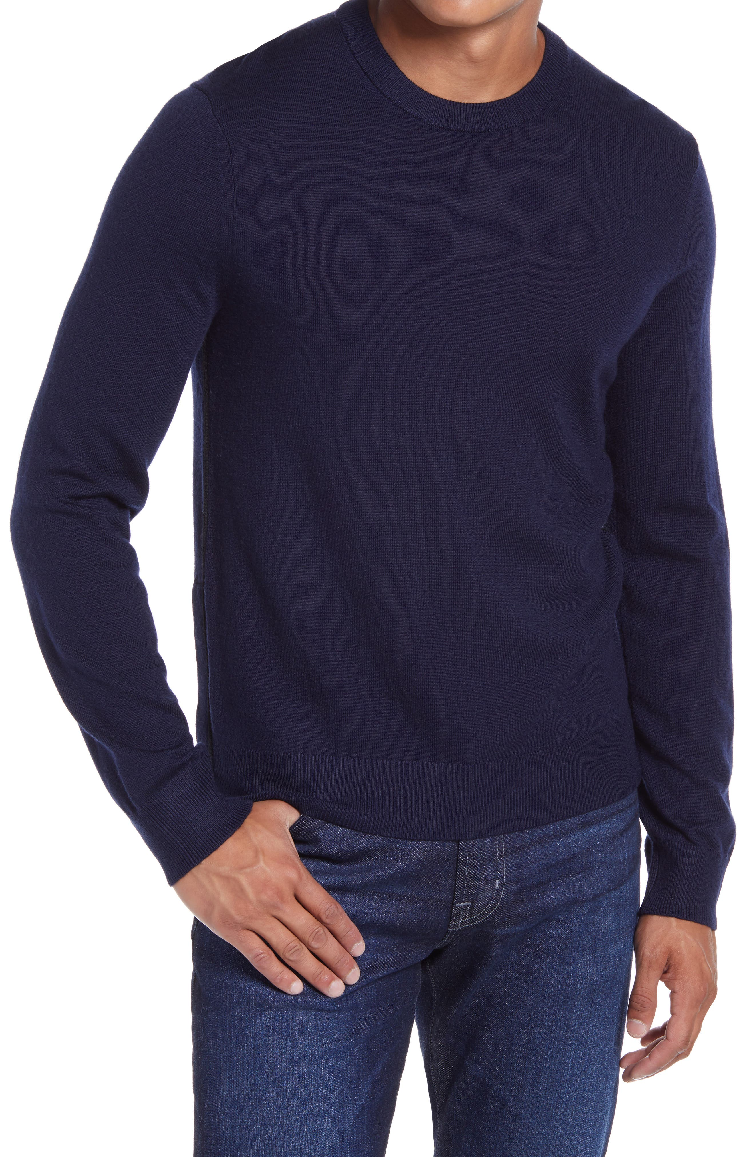 Solid coloring brings easy versatility to a staple crewneck sweater knit for comfort from soft wool yarn in a fit that\\\'s easy to layer or wear on its own. Style Name: Club Monaco Crewneck Wool Sweater. Style Number: 6085932. Available in stores.