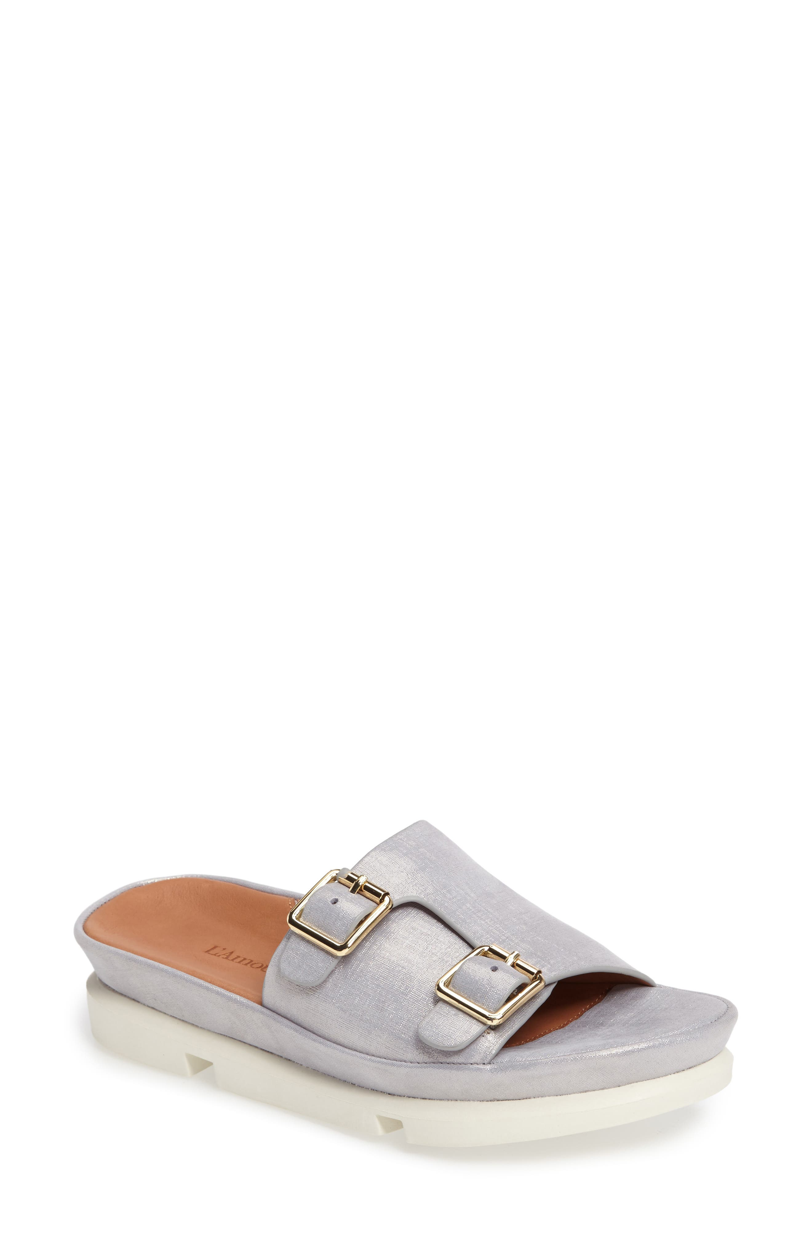 A soft and shimmering leather upper upgrades a comfy slide fitted with a cushioned memory-foam insole and set atop a chunky segmented sole. Style Name:L\\\'Amour Des Pieds Viareggio Slide Sandal (Women). Style Number: 5290198. Available in stores.
