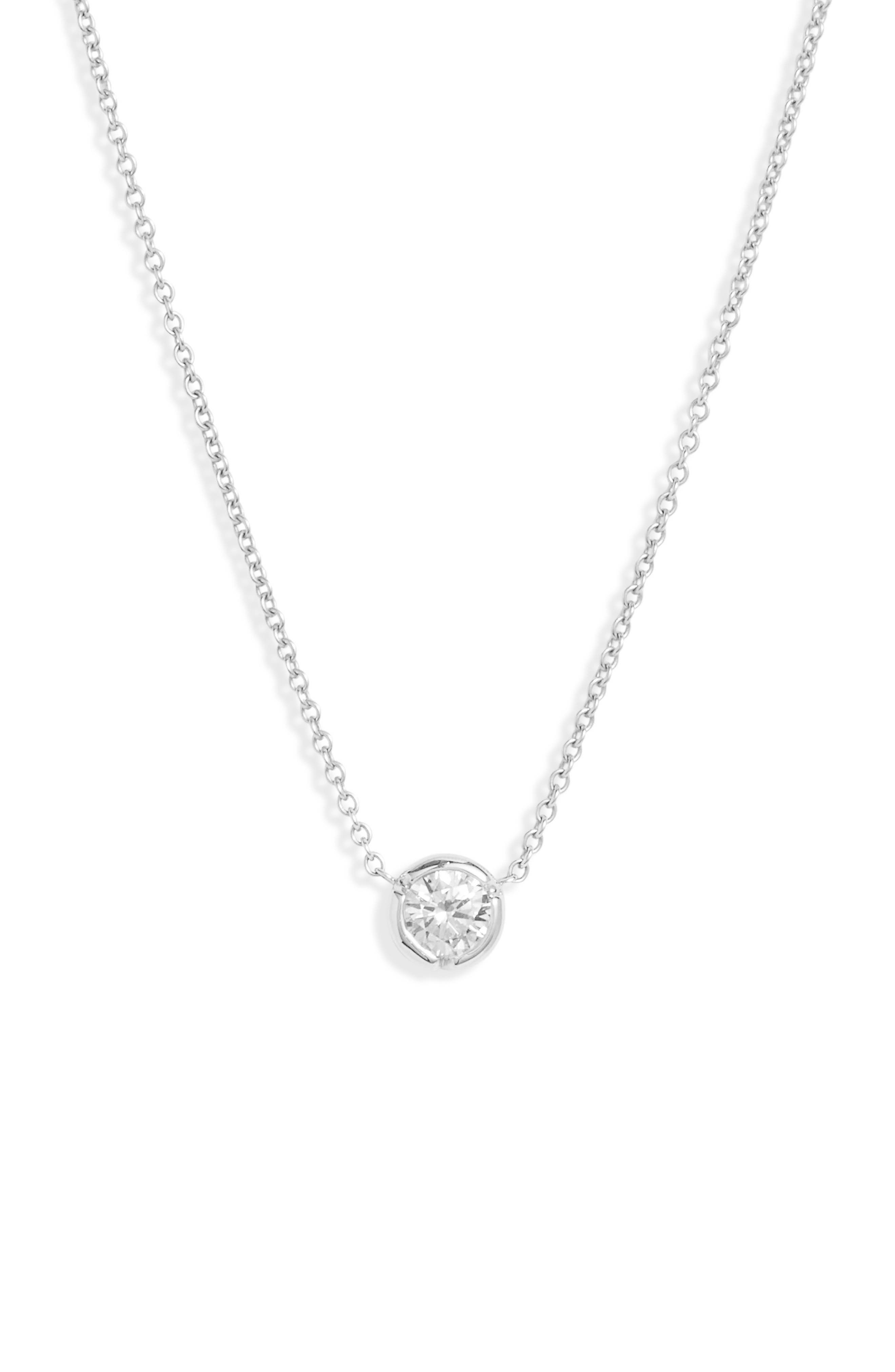 A notched bezel setting refreshes this lovely solitaire necklace that retains its timeless appeal with a fiery round diamond and dainty 18-karat-gold chain. Style Name: Bony Levy Medium Bezel Diamond Solitaire Necklace (Nordstrom Exclusive). Style Number: 5895516. Available in stores.