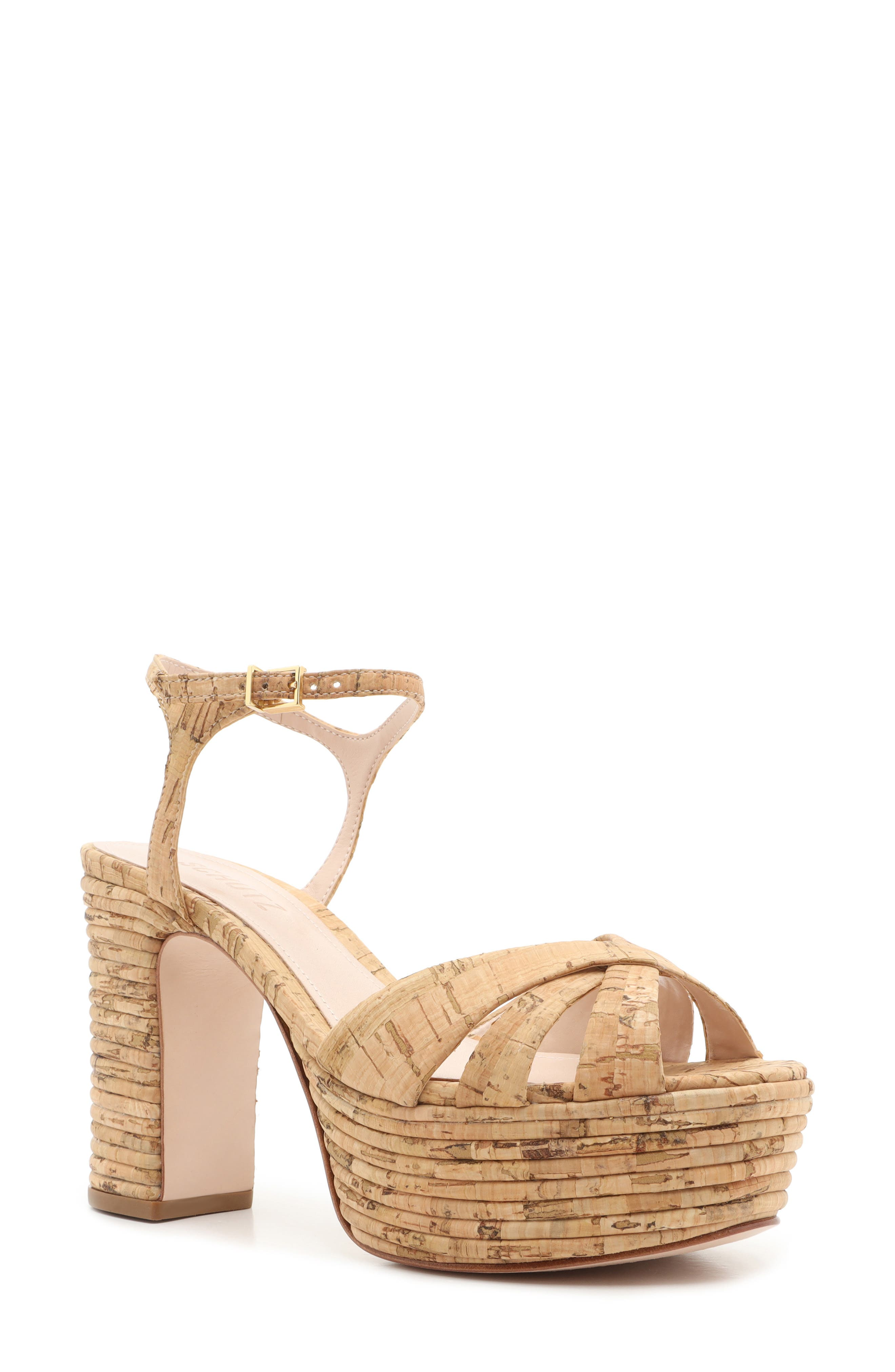 Ribbed bands of cork wrap up the glam-goddess vibe of these towering peep-toe platforms with style to spare. Style Name: Schutz Darila Cork Platform Sandal (Women). Style Number: 6004538. Available in stores.