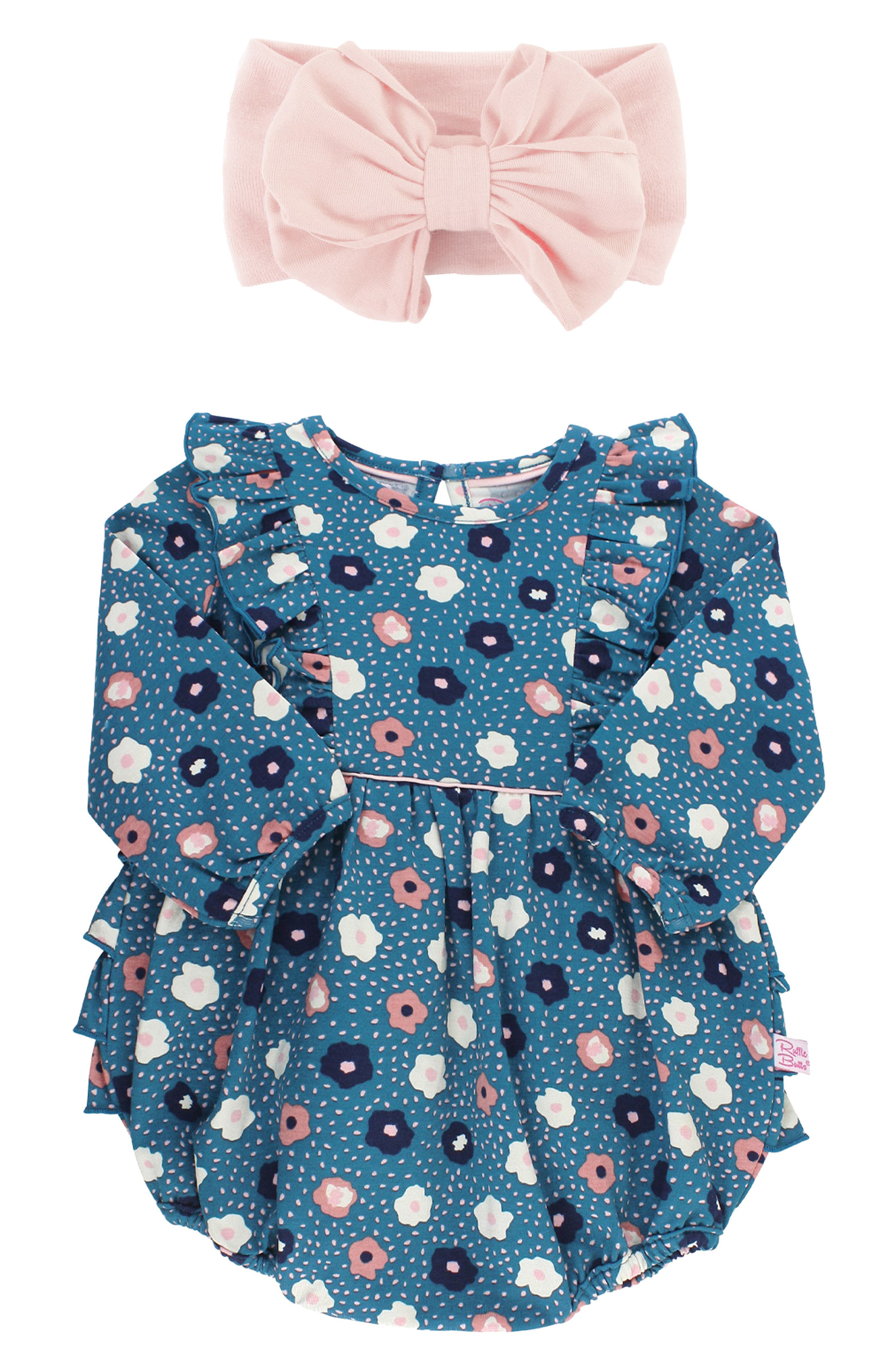 Pretty poppies and fluttery ruffles enliven a soft cotton romper that pairs charmingly with a soft, stretchy head wrap trimmed with a perfectly puckered bow. Style Name: Rufflebutts Poppy Seed Bubble Romper & Head Wrap Set (Baby). Style Number: 6095639. Available in stores.