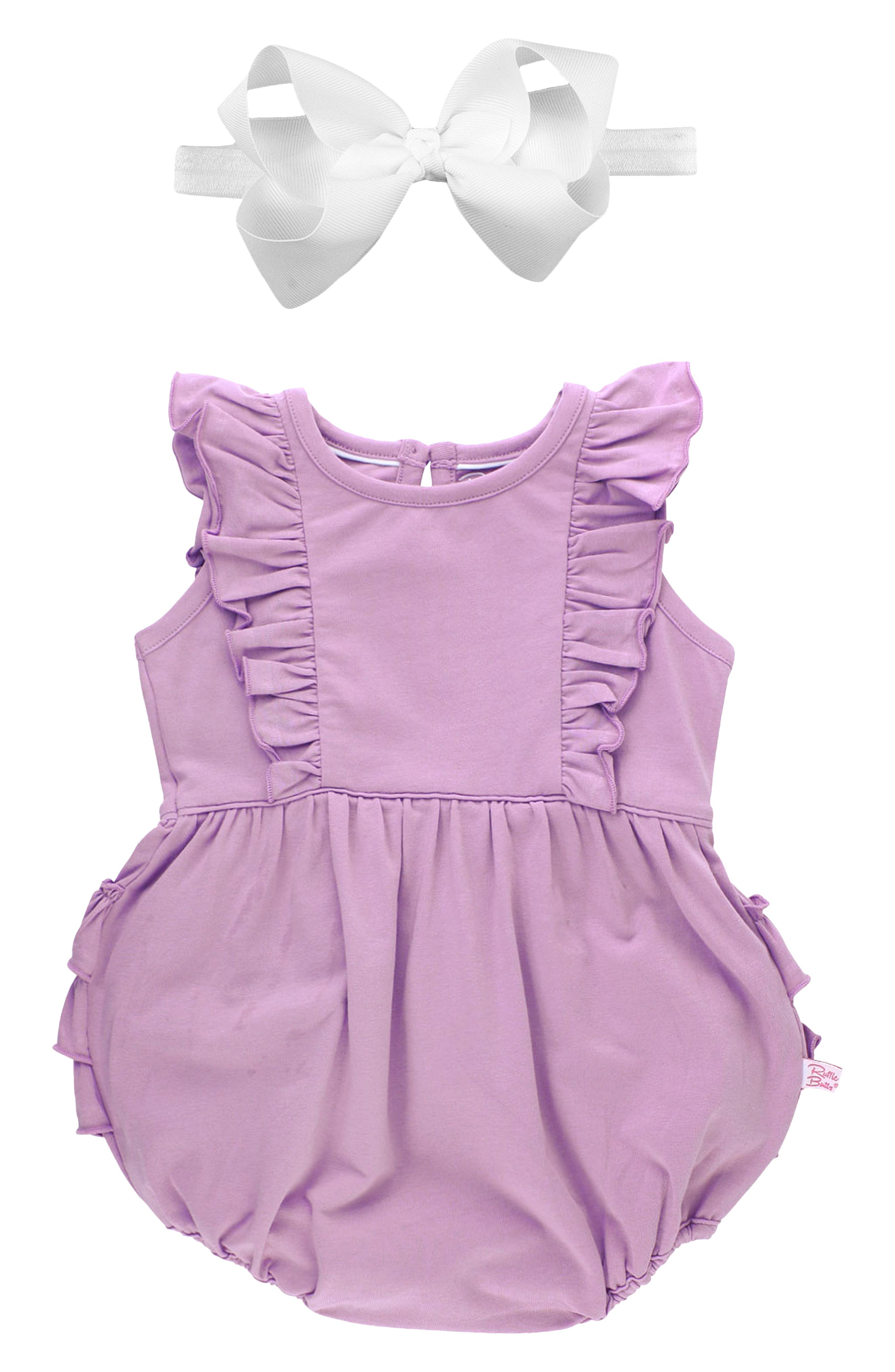 Perfect for sunny days and photo ops, this sweet romper is trimmed with fluttery ruffles and paired with a coordinating grosgrain-ribbon head wrap. Style Name: Rufflebutts Lilac Bubble Romper & Bow Set (Baby). Style Number: 6115693. Available in stores.