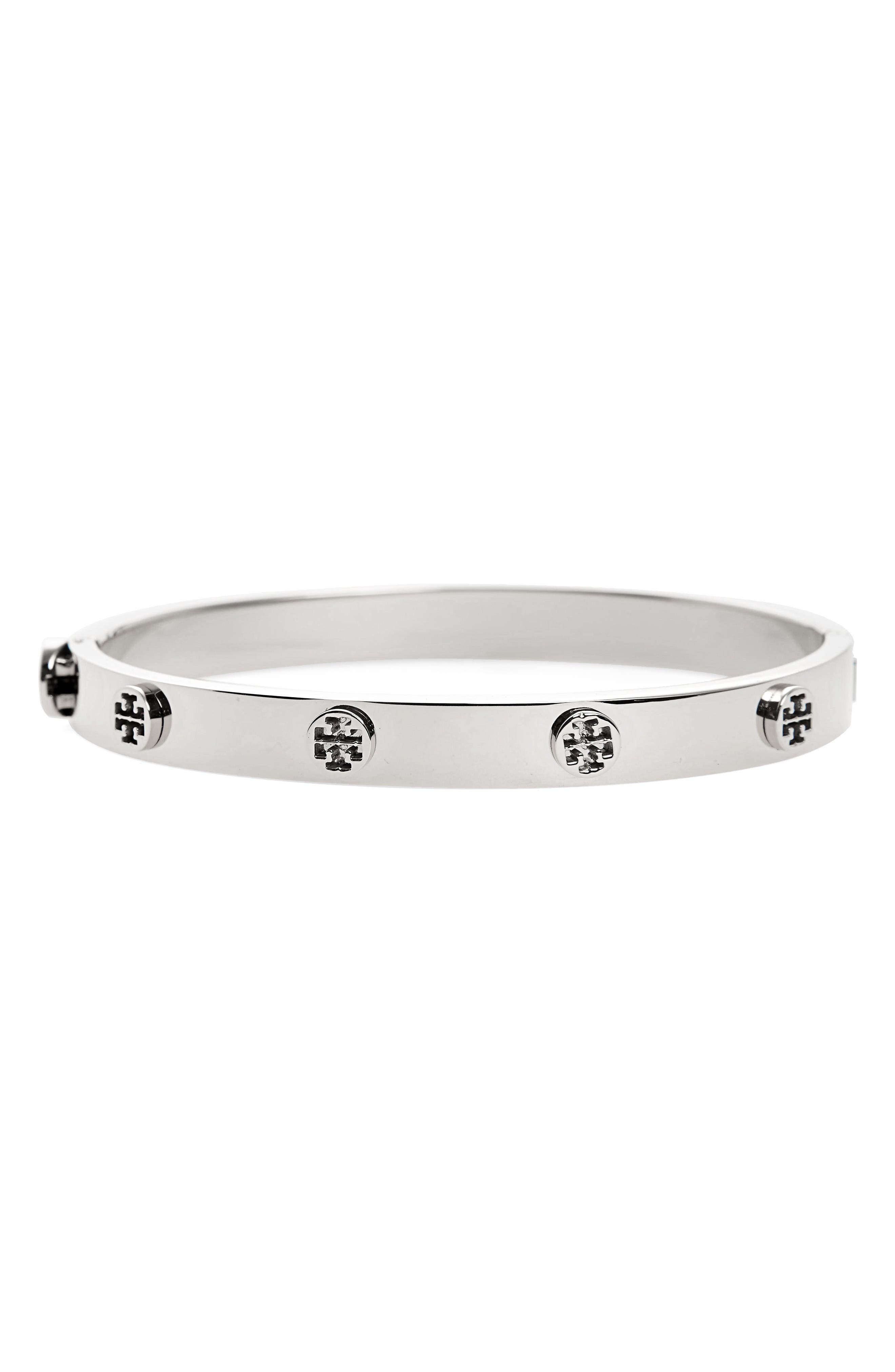 Sculptural studs that serve as graphic representations of Tory Burch\\\'s logo punctuate the fluid silhouette of a glistening bangle perfect for everyday wear. Style Name: Tory Burch Logo Stud Bangle. Style Number: 5285596. Available in stores.