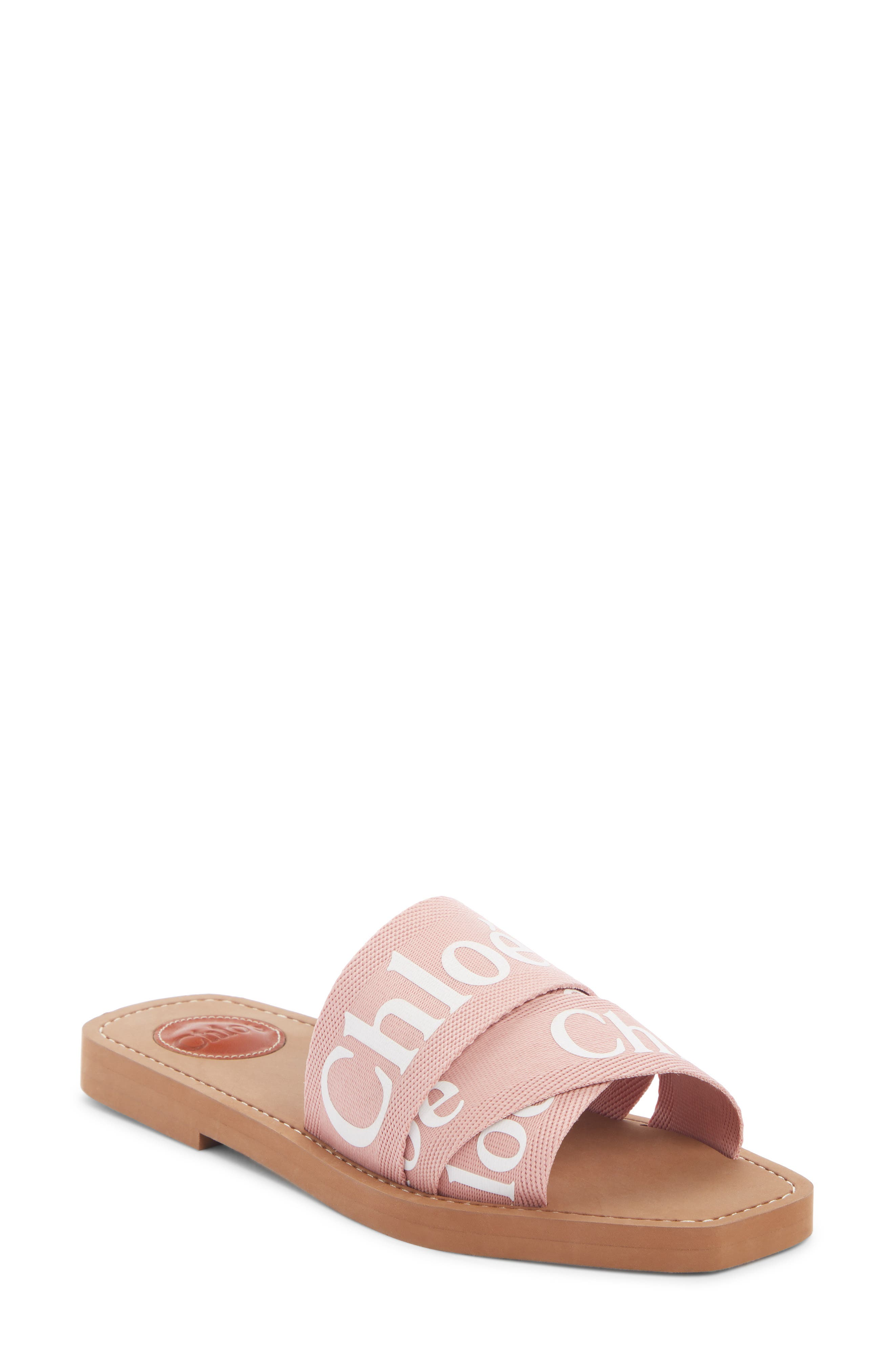 Inspired by lacy pieces in the ready-to-wear collection, this chic slide features delicate woven bands printed with bold logo letters. Style Name: Chloe Logo Slide Sandal (Women). Style Number: 5781136. Available in stores.