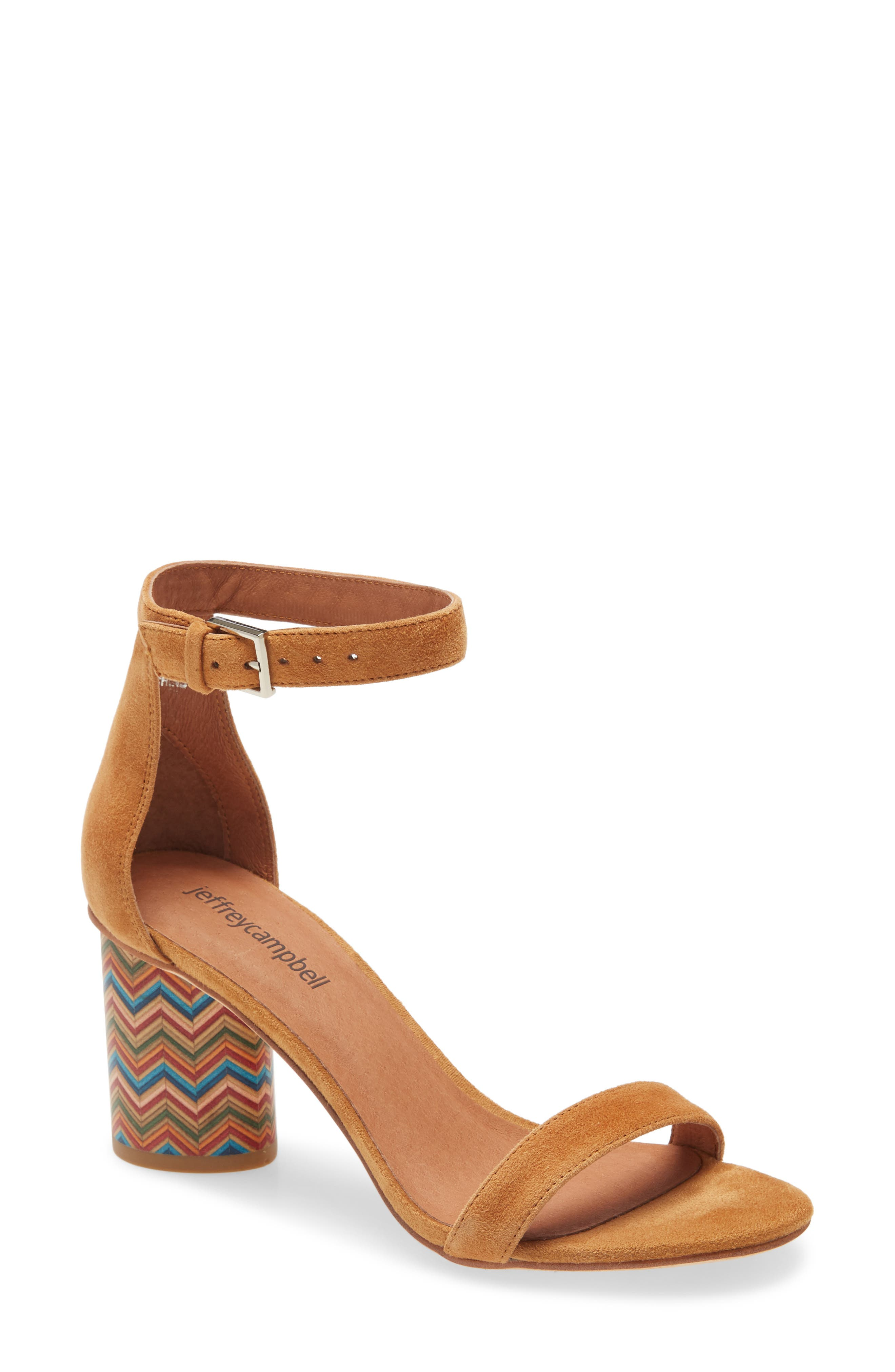 For a mod twist, a classic ankle-strap sandal provides bold pattern and color on its round stacked heel with a geometric design. Style Name: Jeffrey Campbell Purdy Statement Heel Sandal (Women). Style Number: 5805570. Available in stores.