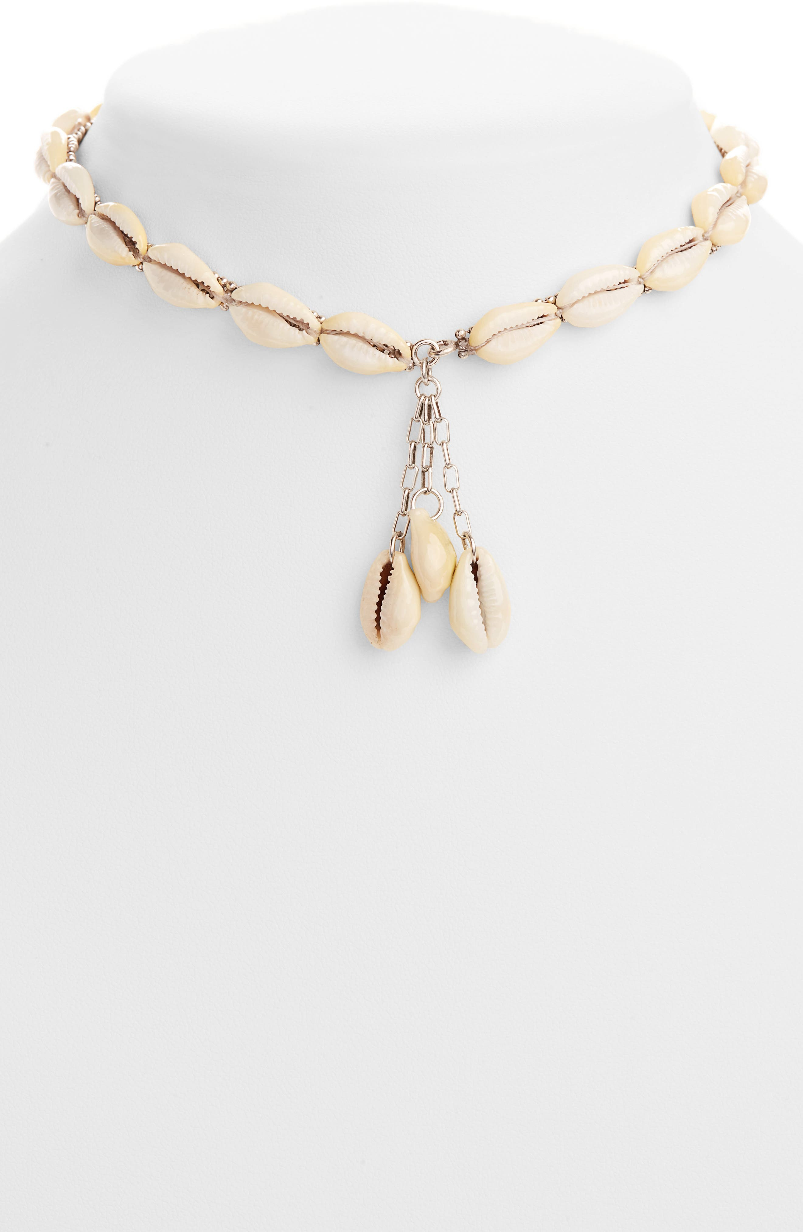 This tropically minded choker necklace boasts pretty cowrie shells that dangle from and trace a ball-beaded chain. Style Name: Isabel Marant Shell Choker Necklace. Style Number: 6023000. Available in stores.