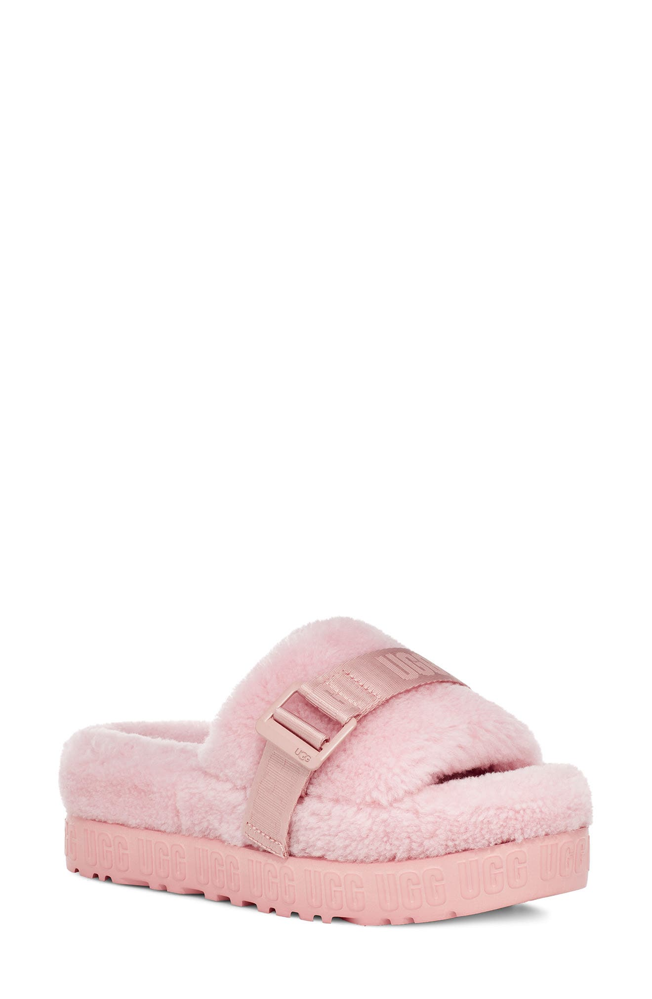 Plush genuine shearling adds undeniable warmth and comfort to an easy slipper with a rubber sole for indoor/outdoor wear. Style Name: UGG Fluffita Genuine Shearling Slipper (Women). Style Number: 6083405. Available in stores.