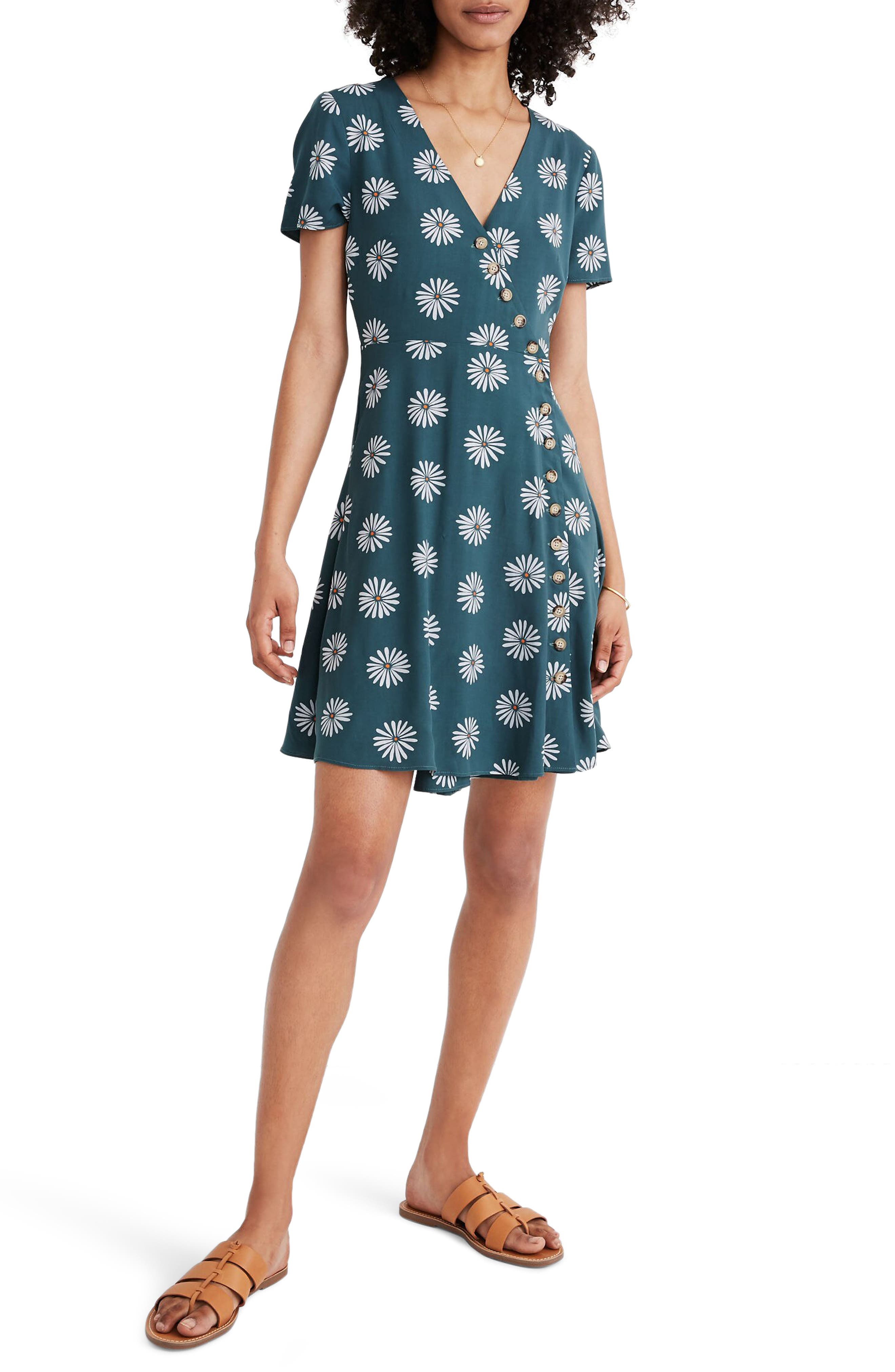 A retro-inspired minidress is styled with asymmetrical buttons that wrap around the front (it\'s so flattering). Style Name: Madewell Daisy Daydream Button Wrap Dress. Style Number: 6036359. Available in stores.