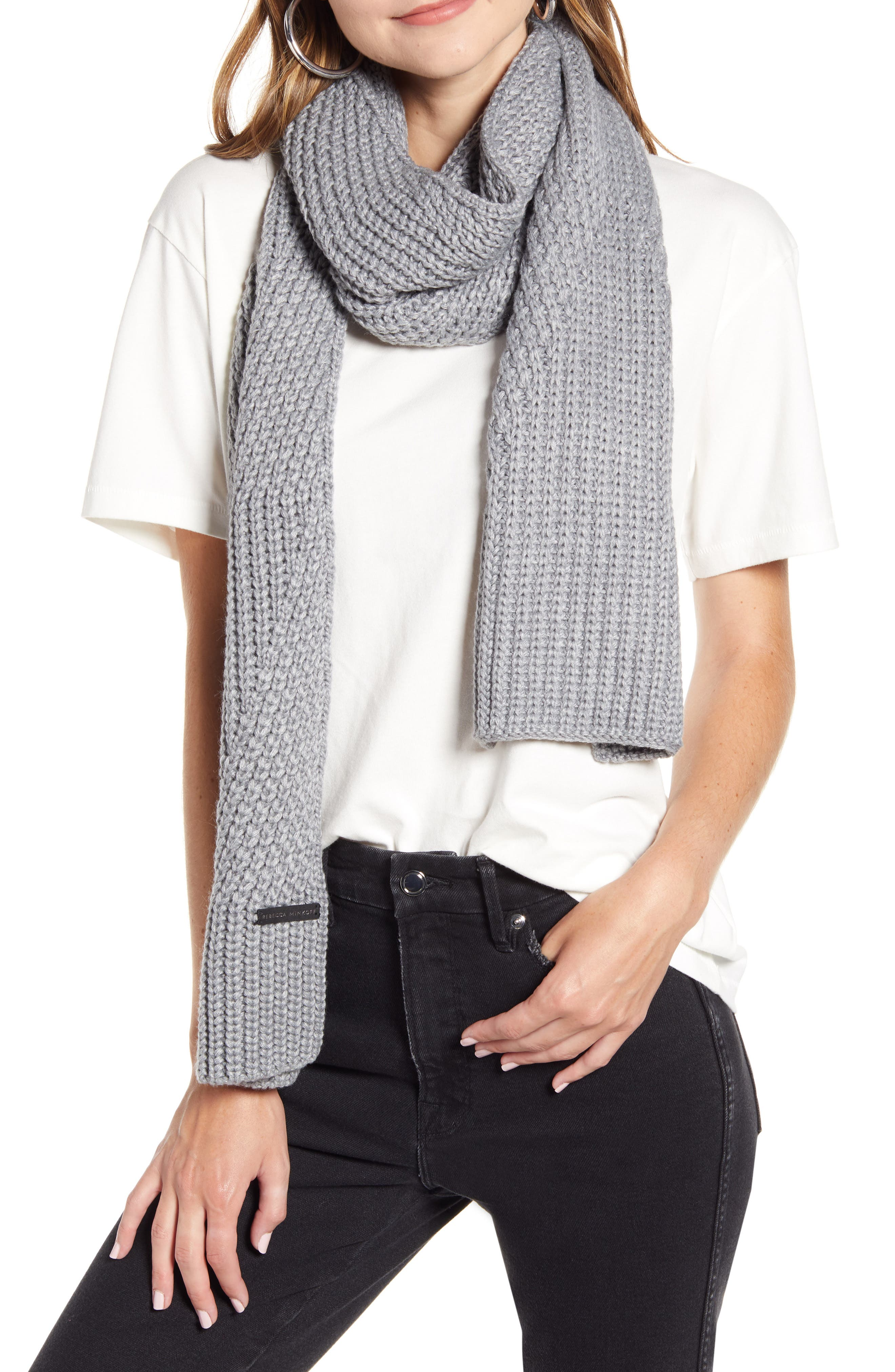 Mixed stitchwork lends subtle depth to this soft and cozy knit scarf. Style Name: Rebecca Minkoff Traveling Rib Scarf. Style Number: 5862495 1. Available in stores.