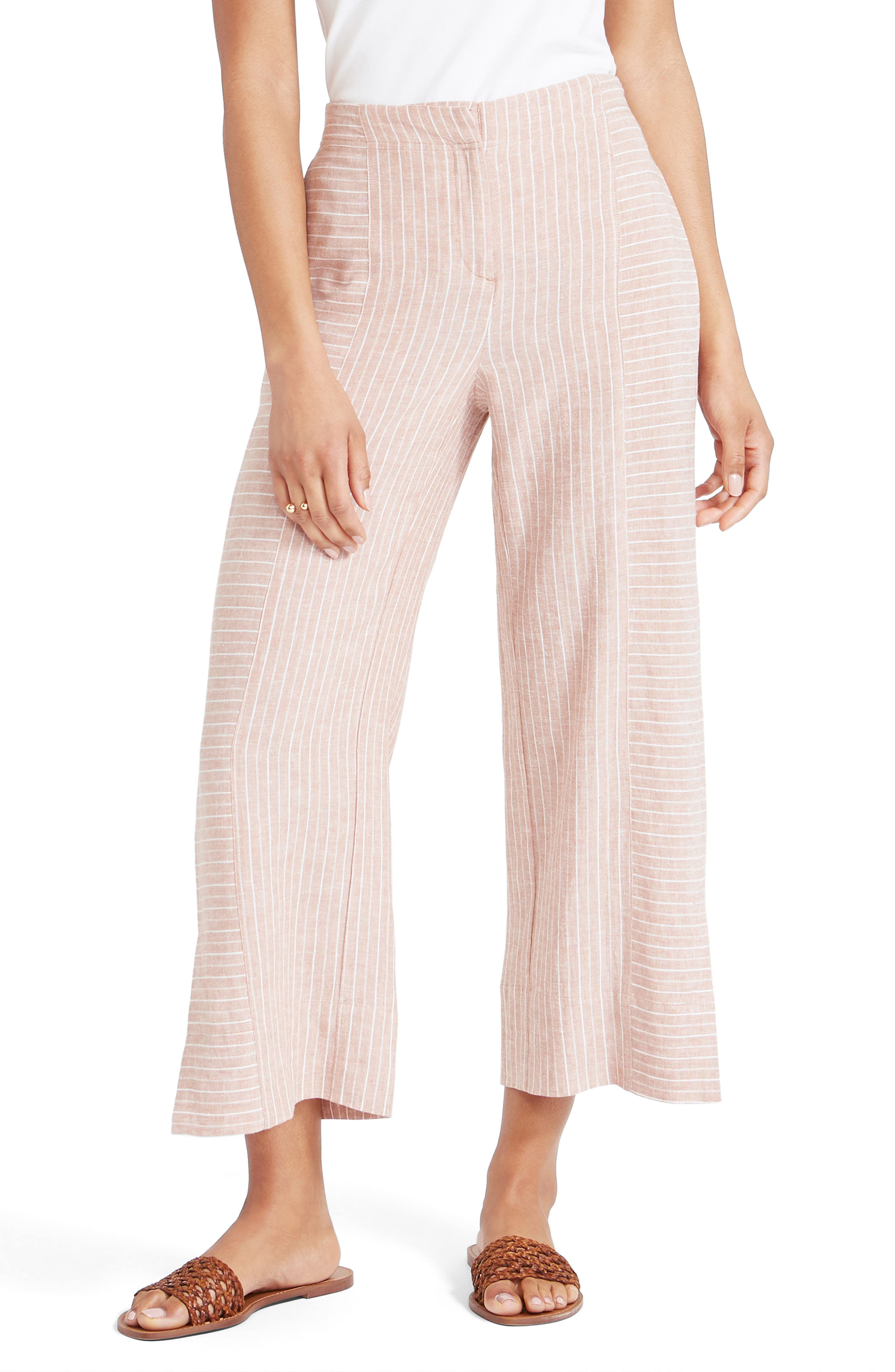 These pinstriped pants check all the right boxes for hot weather: easy pull-on styling, breezy wide legs and a linen blend with a cool, crisp look and feel. Style Name: Nic+Zoe Central Park Crop Pants (Regular & Petite). Style Number: 6039906. Available in stores.