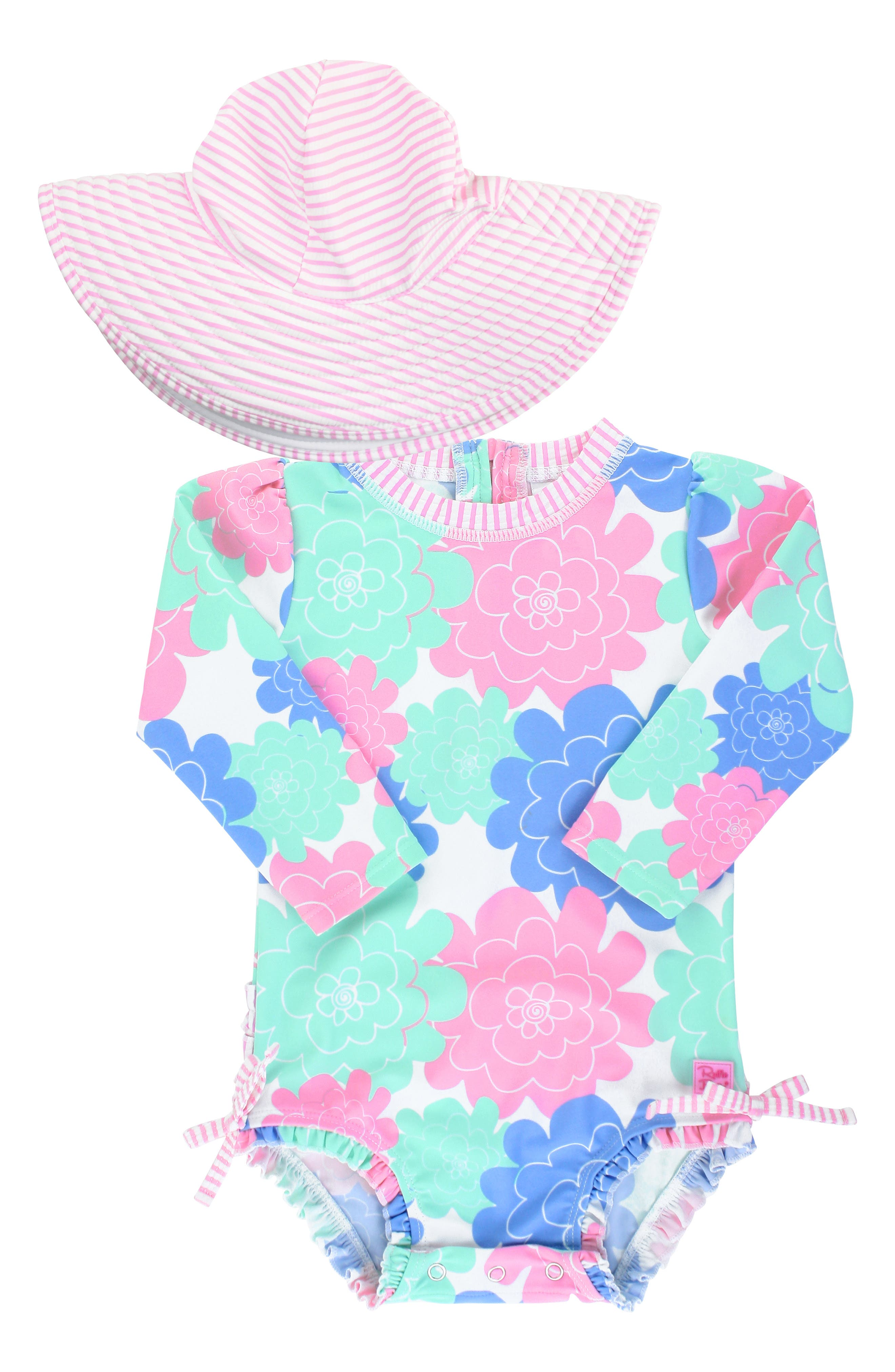 Pastel flowers and ruffled trim add ample retro charm to a beach-ready rashguard swimsuit paired with an adorable floppy hat for extra sun protection. Style Name: Rufflebutts Pastels One-Piece Rashguard Swimsuit & Floppy Hat Set (Baby). Style Number: 5938568. Available in stores.