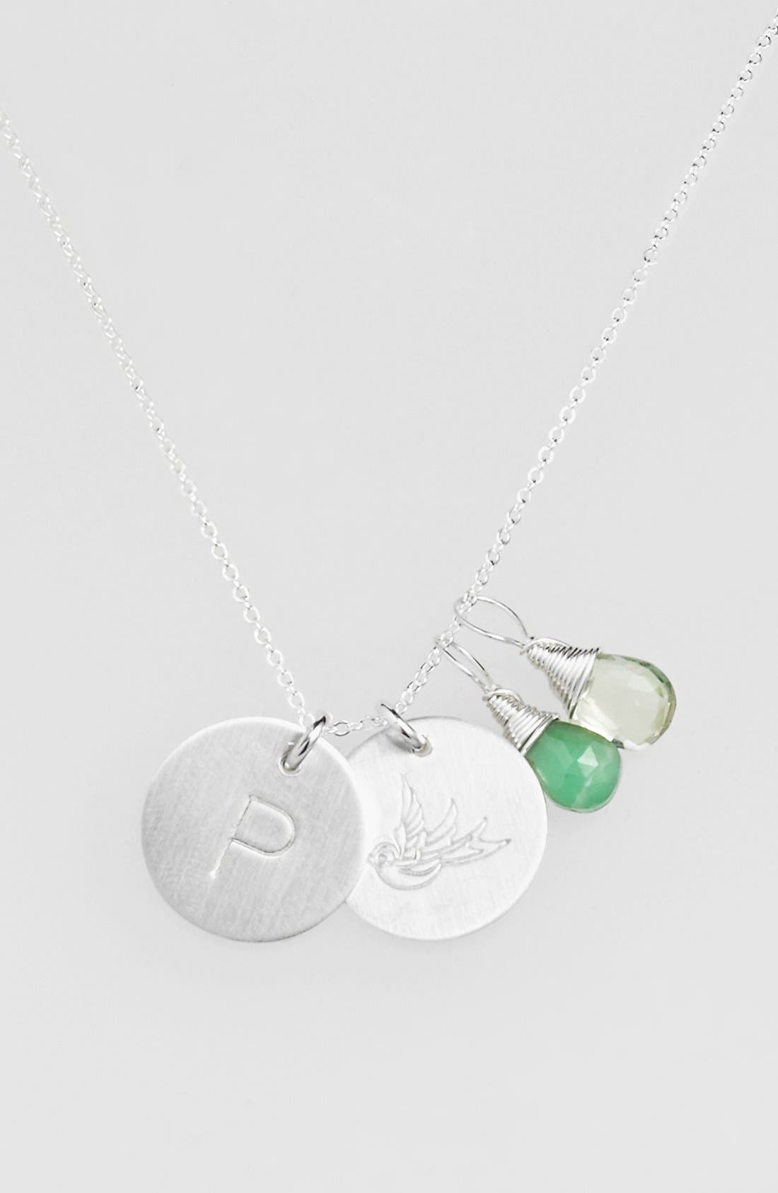 From humble beginnings to a fully staffed warehouse in Bend, Oregon, Nashelle remains true to its original purpose-handmade jewelry crafted with love and intention. Two dainty wire-wrapped gemstones add color and dazzle to a keepsake necklace with additional pendants, including one hand-stamped swallow and one hand-stamped initial. The swallow symbol represents love, loyalty and a safe return home. Style Name: Nashelle Green Amethyst Initial &