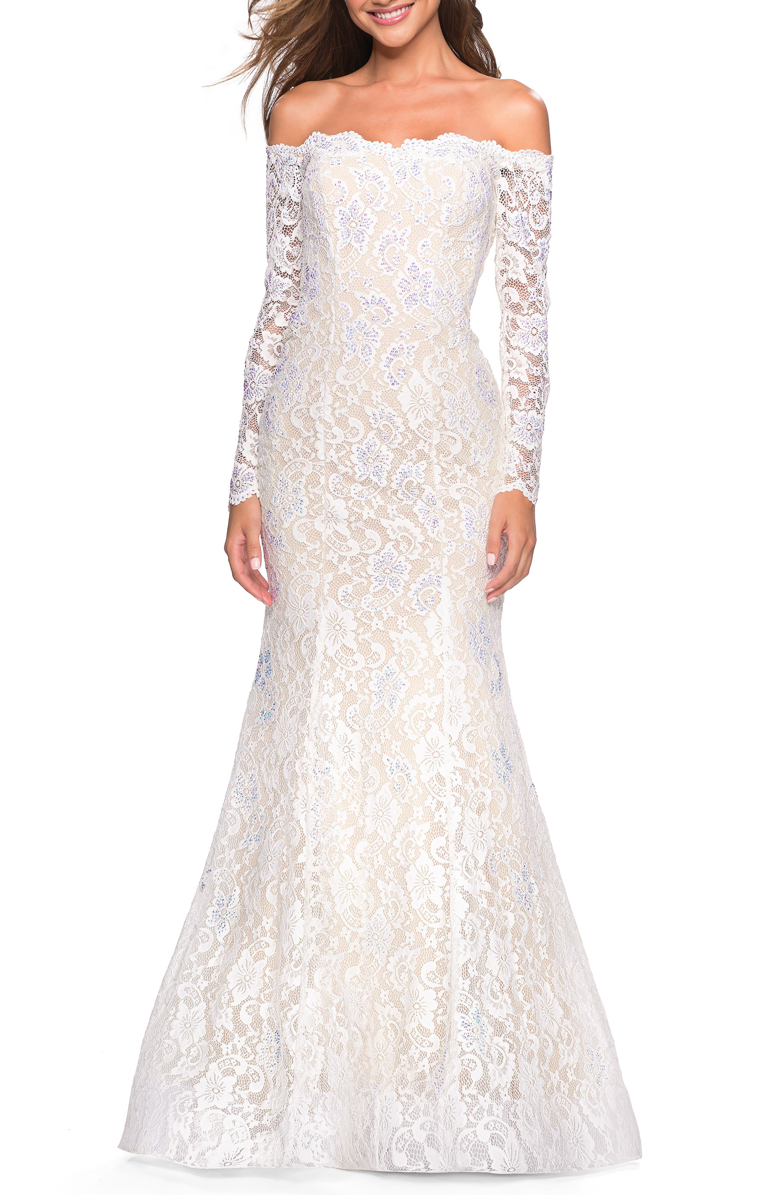 Bring enchantment to your evening in this shoulder-baring gown covered in delicate floral lace with a back cutout and long illusion sleeves. Style Name: La Femme Off The Shoulder Long Sleeve Lace Gown. Style Number: 6043011. Available in stores.