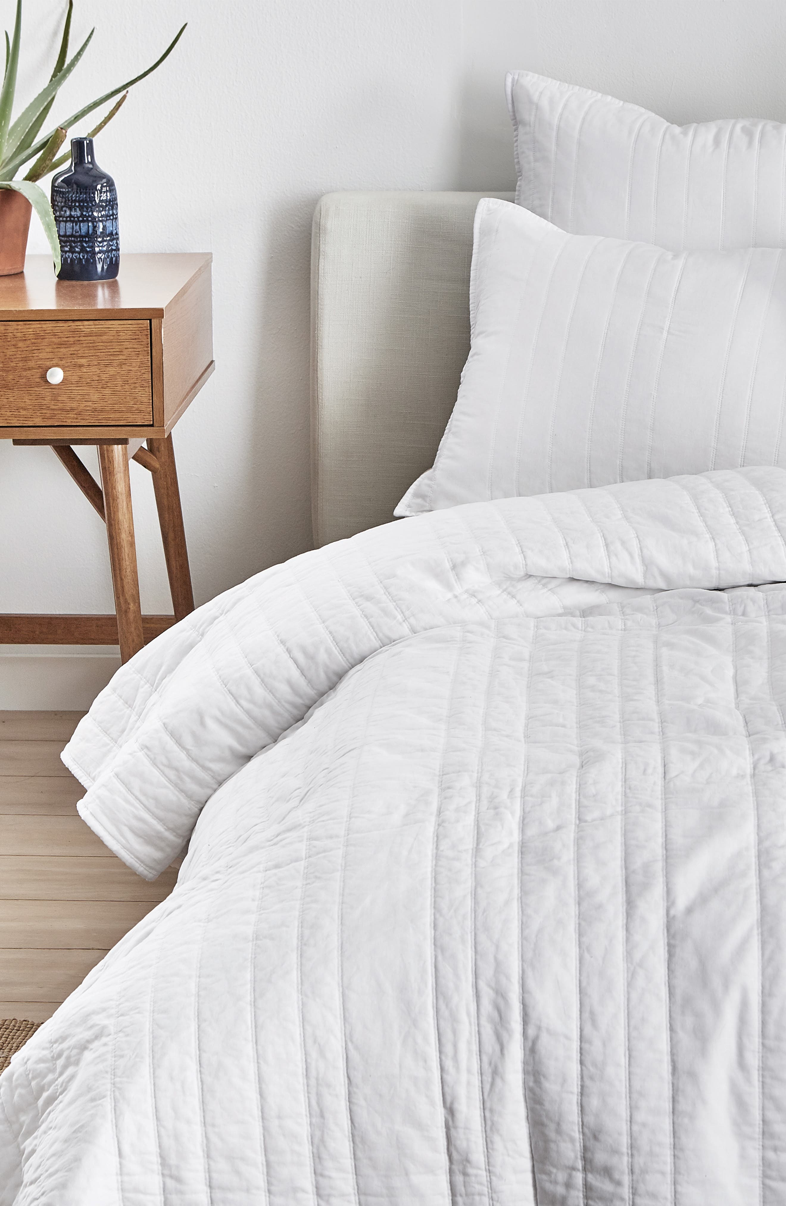 Give your bedroom decor a crisp yet cozy look with this reversible coverlet quilted in a varied-stripe pattern. Style Name: Splendid Home Decor Reversible Coverlet. Style Number: 5692671. Available in stores.