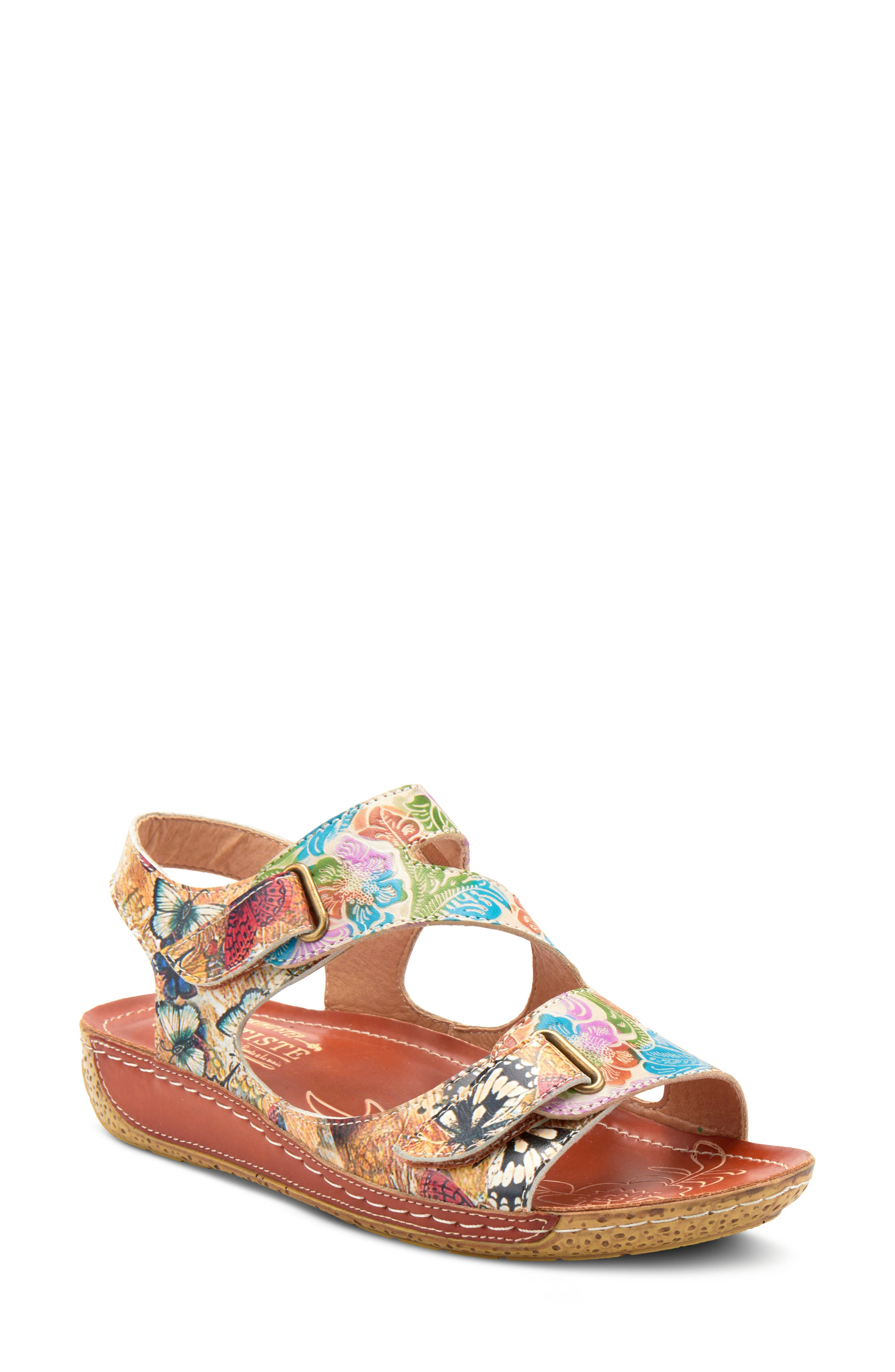 Hand-painted details and natural tanned leather call attention to a boldly patterned sandal set on a low platform and wedge. Style Name:L\\\'Artiste Symphony Sandal (Women). Style Number: 6000069. Available in stores.