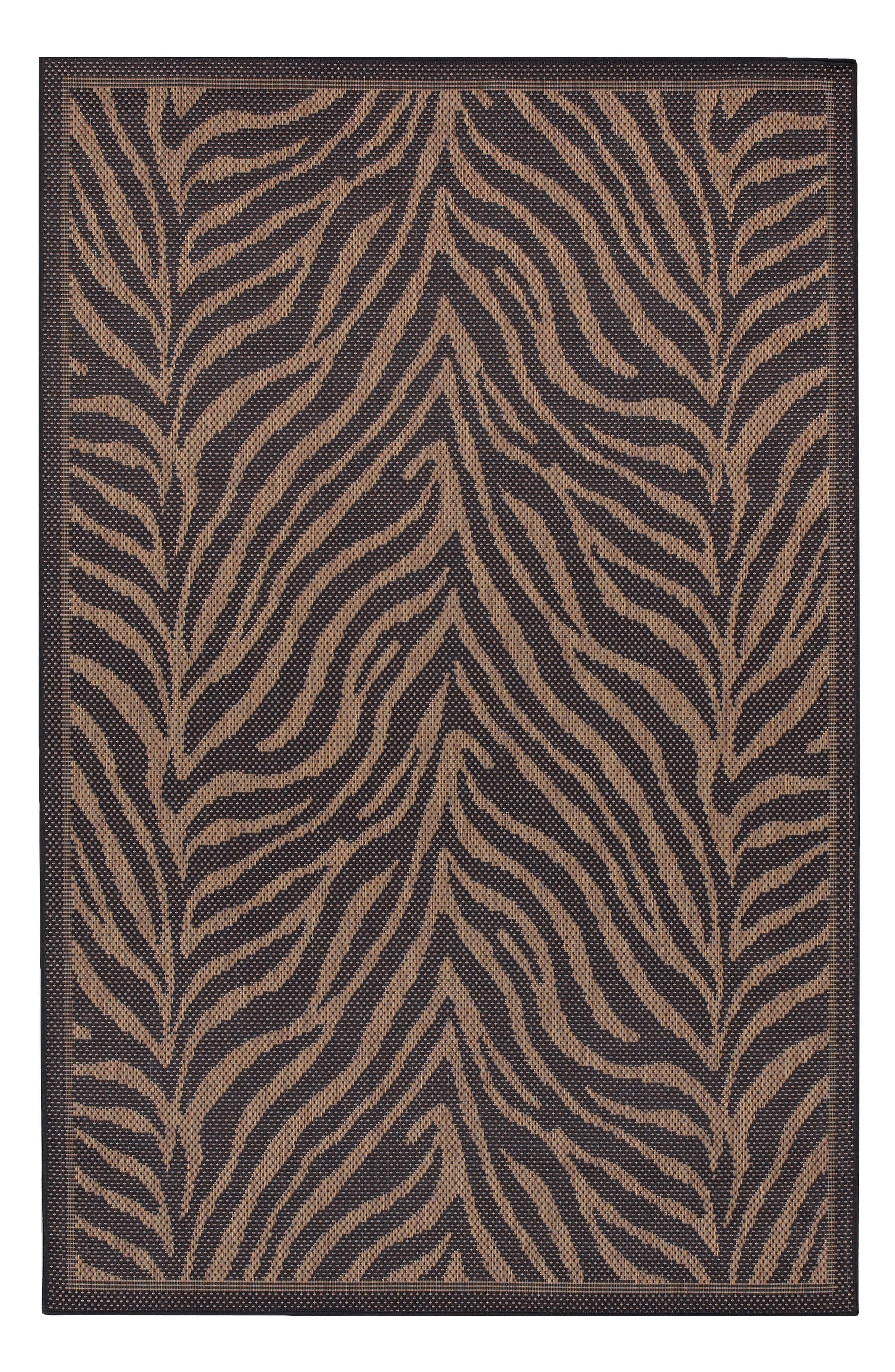 Muted zebra stripes add a subtly wild touch to a versatile rug power-loomed in fade-resistant polypropylene, making it great for high-traffic areas both inside and outside. Style Name: Couristan Recife Zebra Indoor/outdoor Rug. Style Number: 5368541. Available in stores.