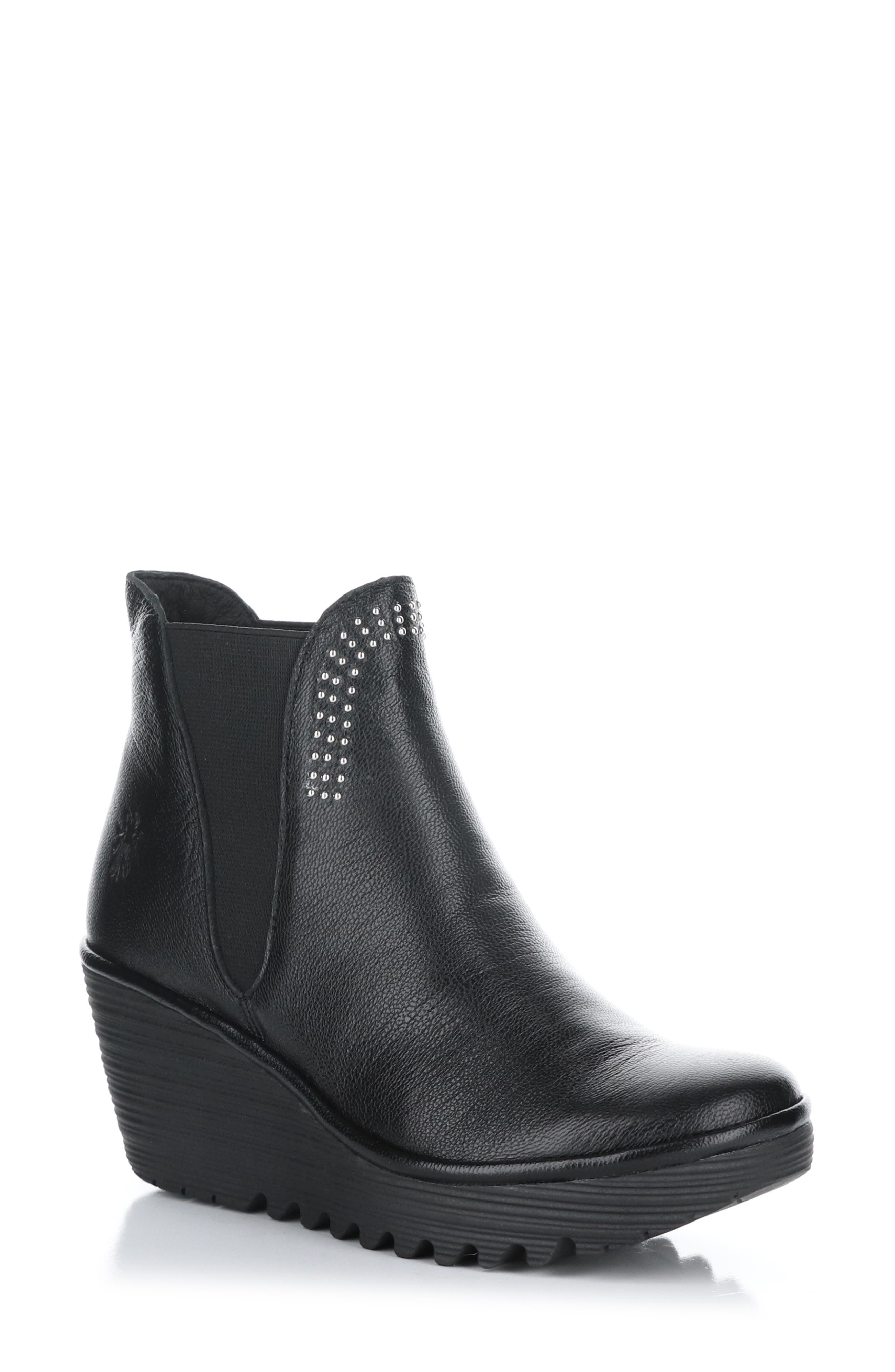 Tiny studs gleam on this water-resistant bootie crafted with soft, breathable leather and a flexible rubber-wedge sole for comfort. Style Name: Fly London Yoss Water Resistant Wedge Bootie (Women). Style Number: 6094476. Available in stores.