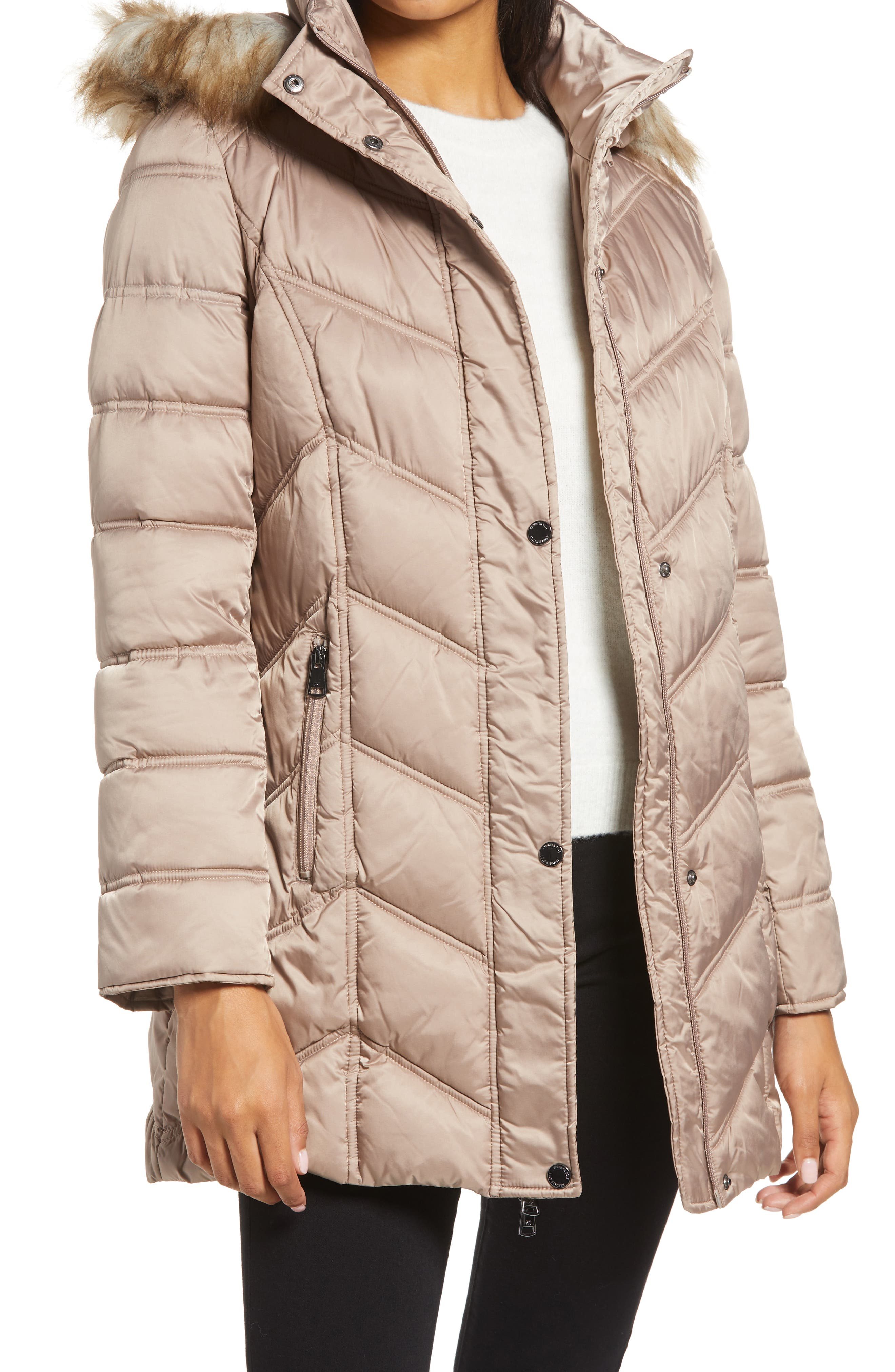 Chevron-shaped quilting puts a contemporary twist on a classic puffer jacket styled with a removable hood trimmed in sumptuous faux fur. Style Name: Kenneth Cole New York Faux Fur Trim Puffer Jacket. Style Number: 5680926. Available in stores.