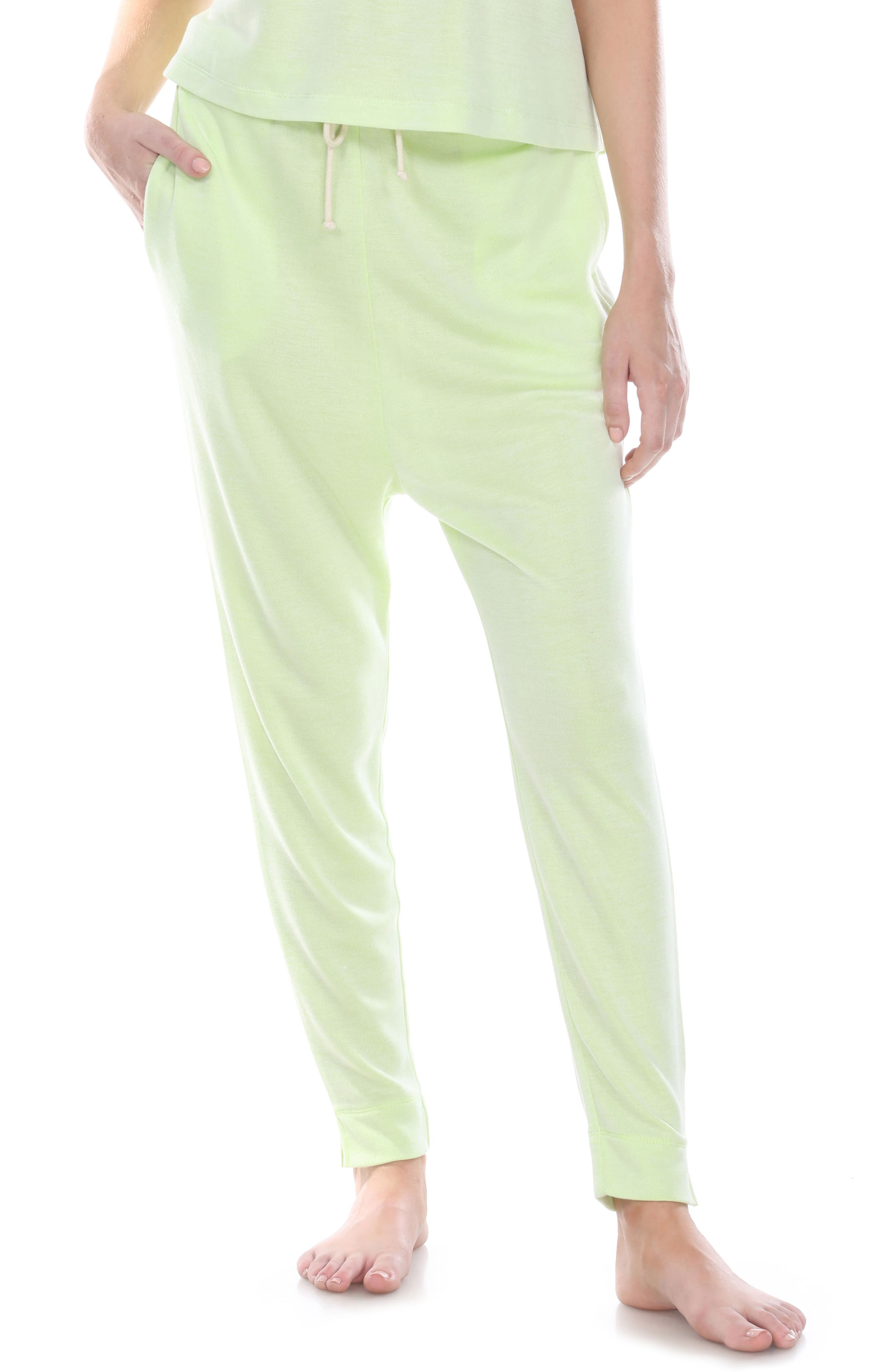 Take it easy in these soft and lightweight lounge pants that have split cuffs and an adjustable drawstring at the waist perfect for staying comfy on the couch. Style Name: Honeydew Intimates Sun Soaker Lounge Sweatpants. Style Number: 6051218. Available in stores.