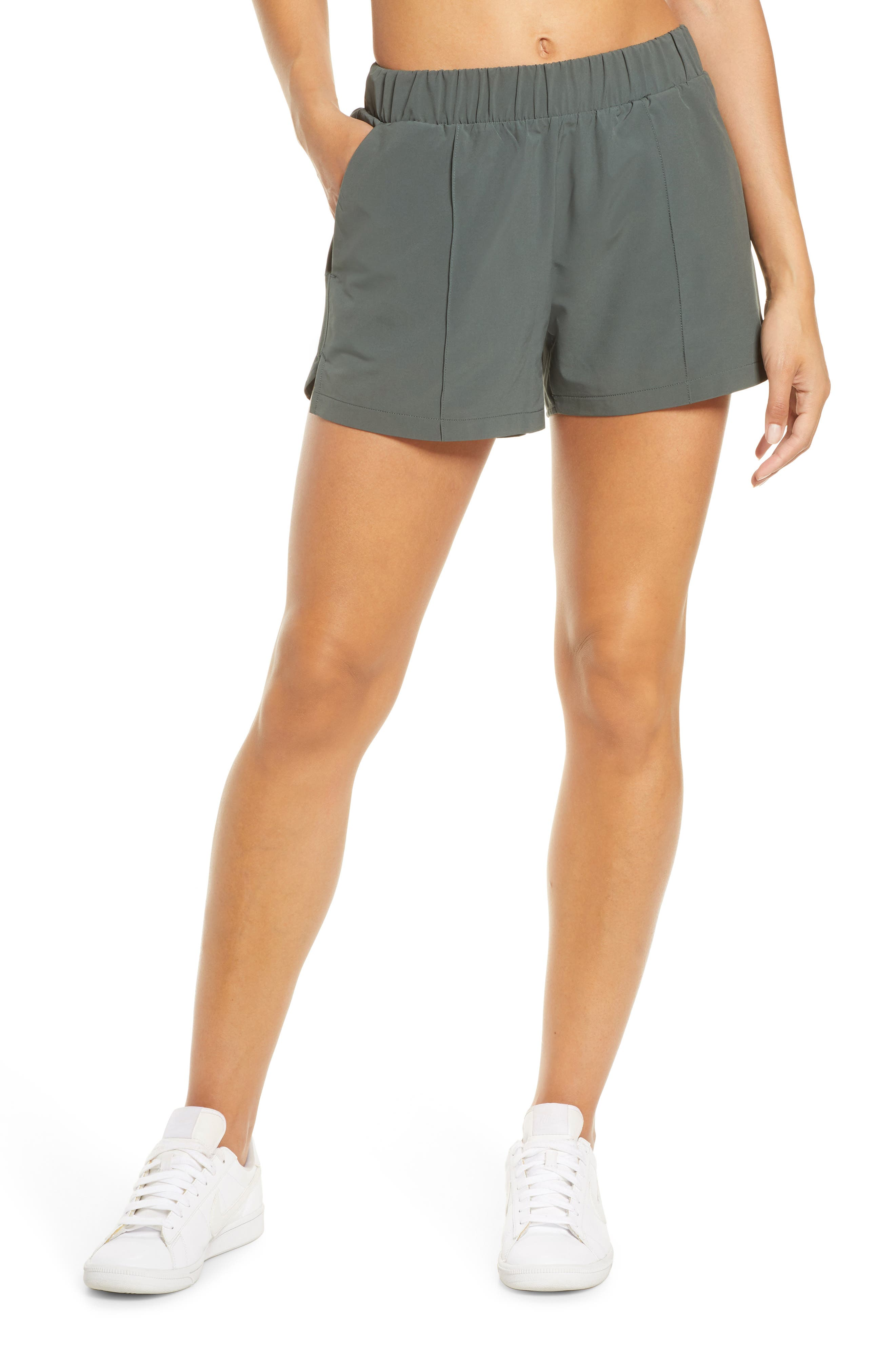 Lightweight shorts in a recycled woven stretch fabric boast an easy elastic waist and movement-friendly vented hems, making them perfect for travel or workouts. A side-seam zip pocket securely stashes cash or a key. Style Name: Zella Taylor Getaway High Waist Recycled Polyester Shorts. Style Number: 5962769. Available in stores.