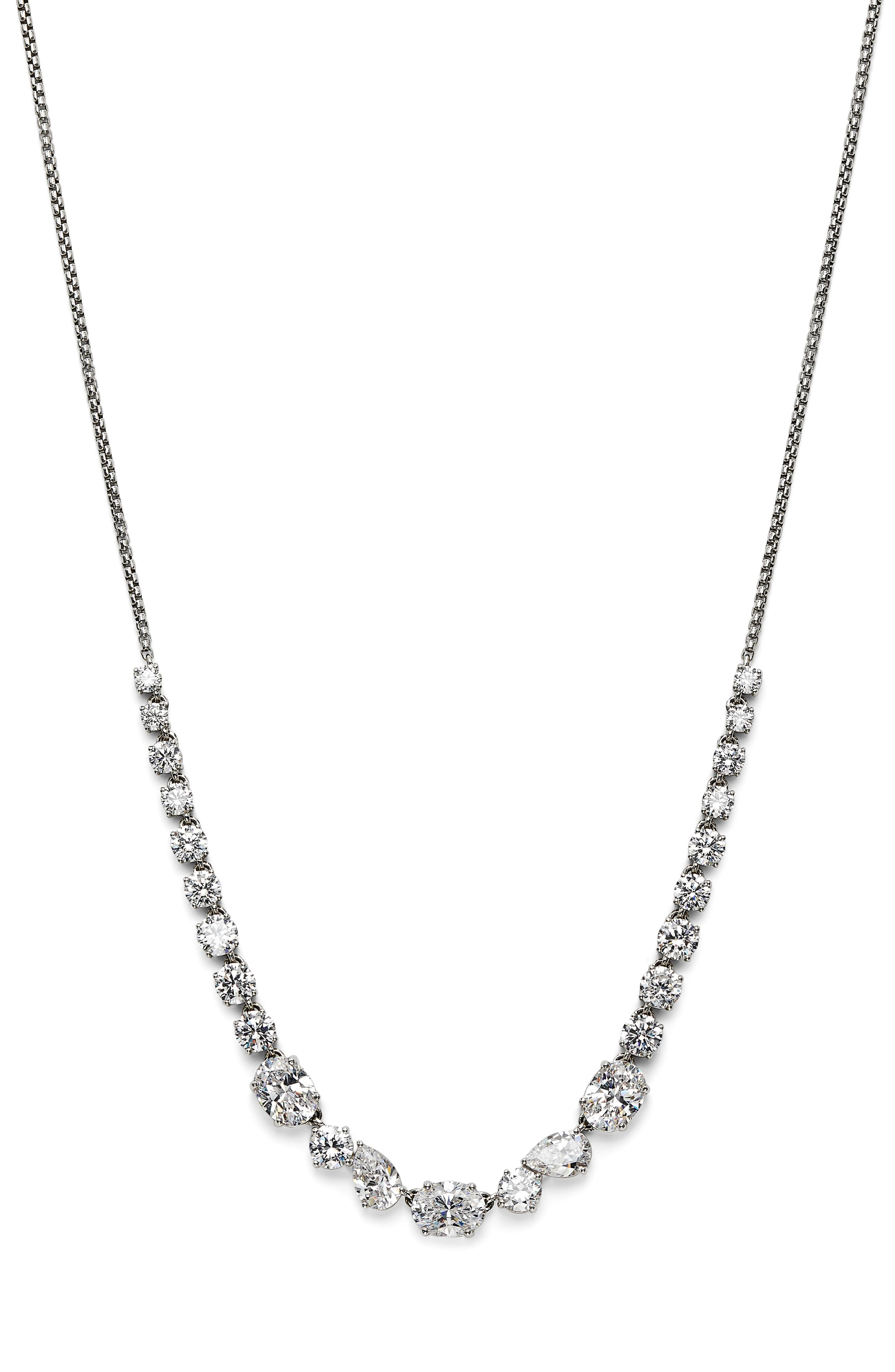 Round and teardrop-shaped stones add eye-catching sparkle and shine to this hand-polished chain-link necklace. Style Name: Nadri Chloe Cubic Zirconia Necklace. Style Number: 6106209. Available in stores.