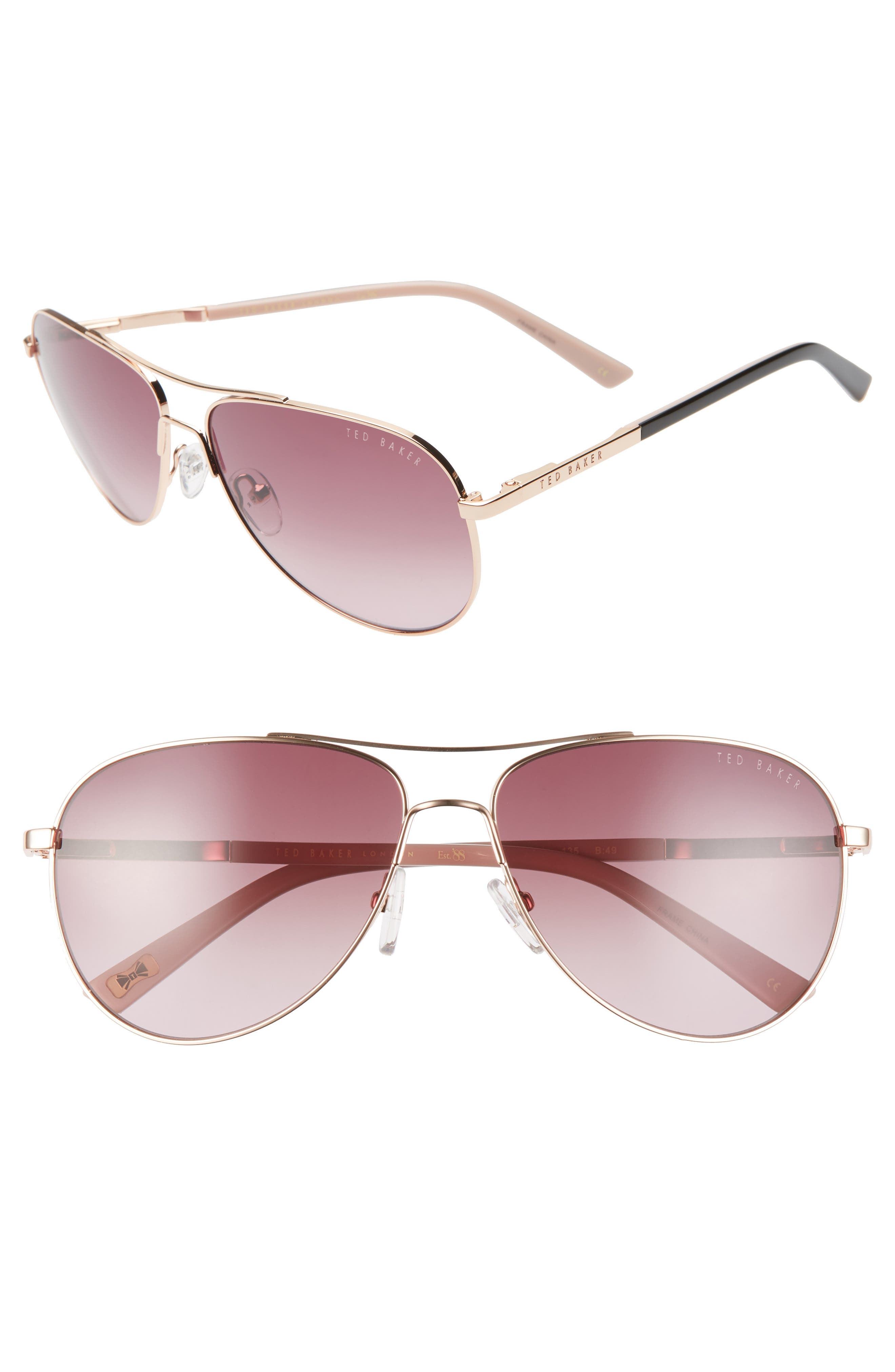 Softly tinted gradient lenses add romance to classic aviator sunglasses with slender metal frames. Style Name: Ted Baker London 58mm Tinted Gradient Aviator Sunglasses. Style Number: 5987438. Available in stores.