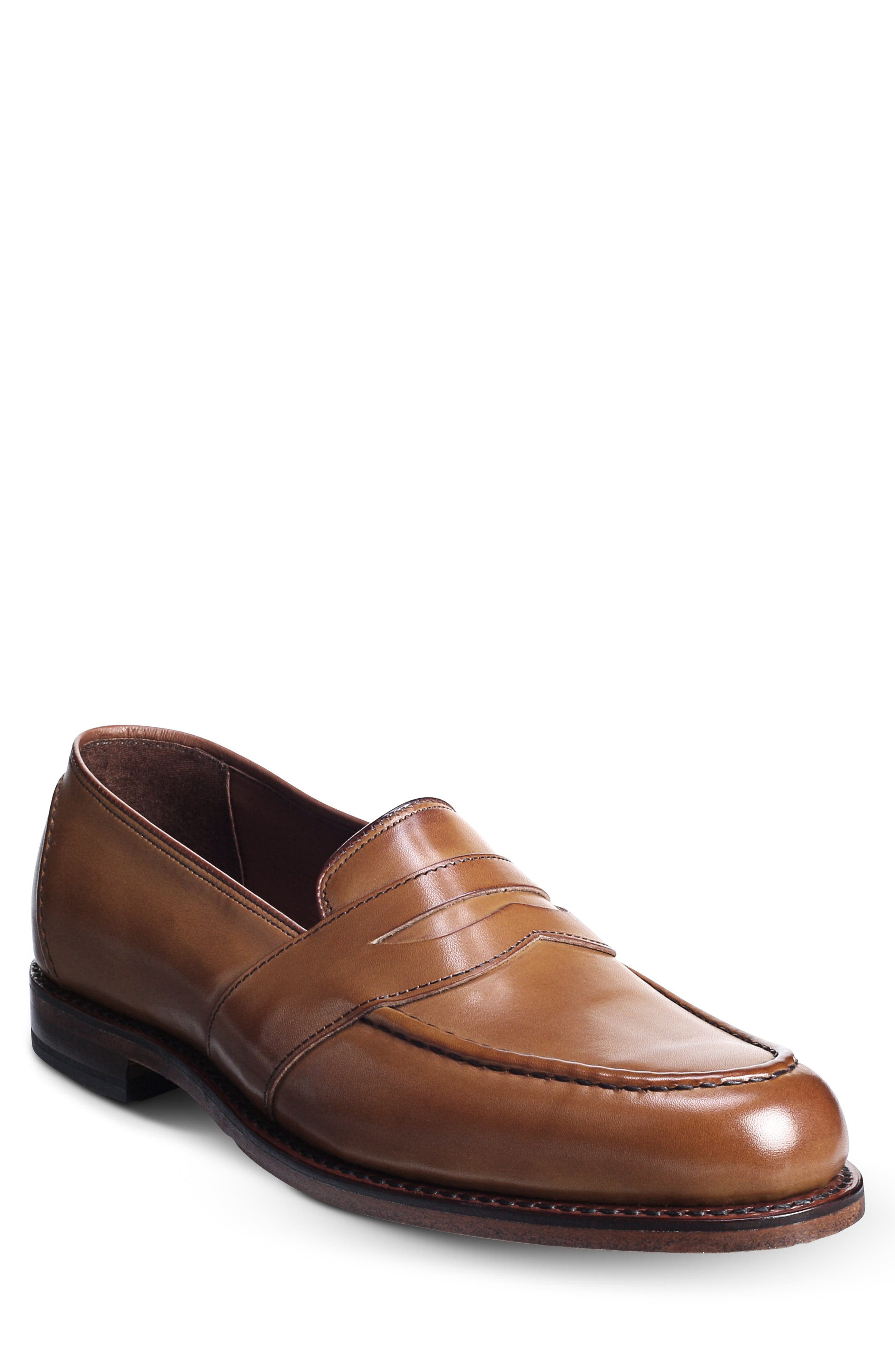 A sleek penny loafer features handsome welted construction and earthy leather for a classic picture. Allen Edmonds has been making shoes in America for nearly 100 years using fine leathers, a 212-step crafting process and 360 degree Goodyear welt construction to allow for recrafting to extend the life of the shoe. Style Name: Allen Edmonds Randolph Loafer (Men). Style Number: 126721. Available in stores.