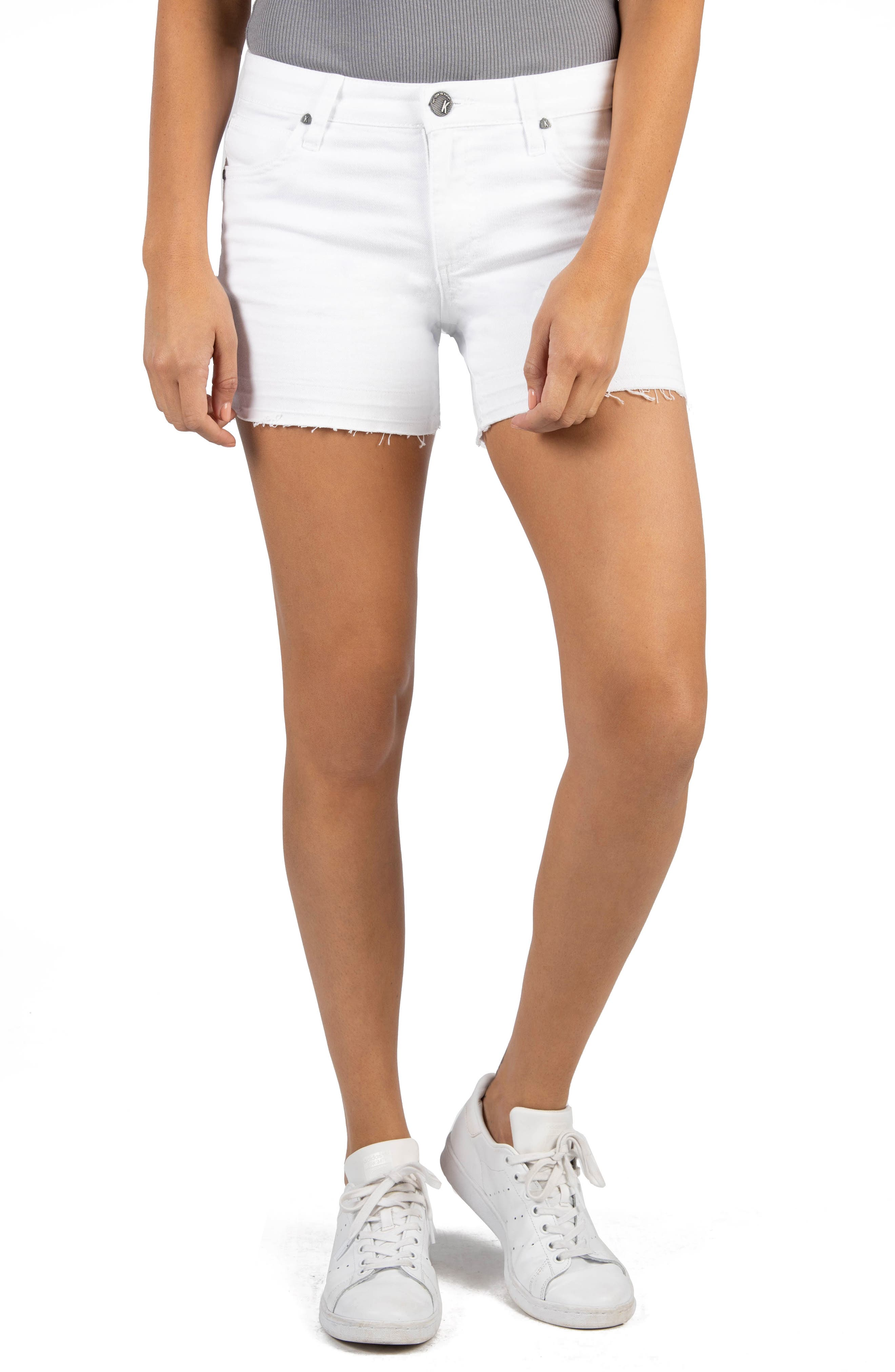 Take a trend-right approach to white shorts season in these stretch-kissed shorts that feature undone, raw hems. Style Name: Kut From The Kloth Andrea Release Hem Denim Cutoff Shorts. Style Number: 6018159. Available in stores.