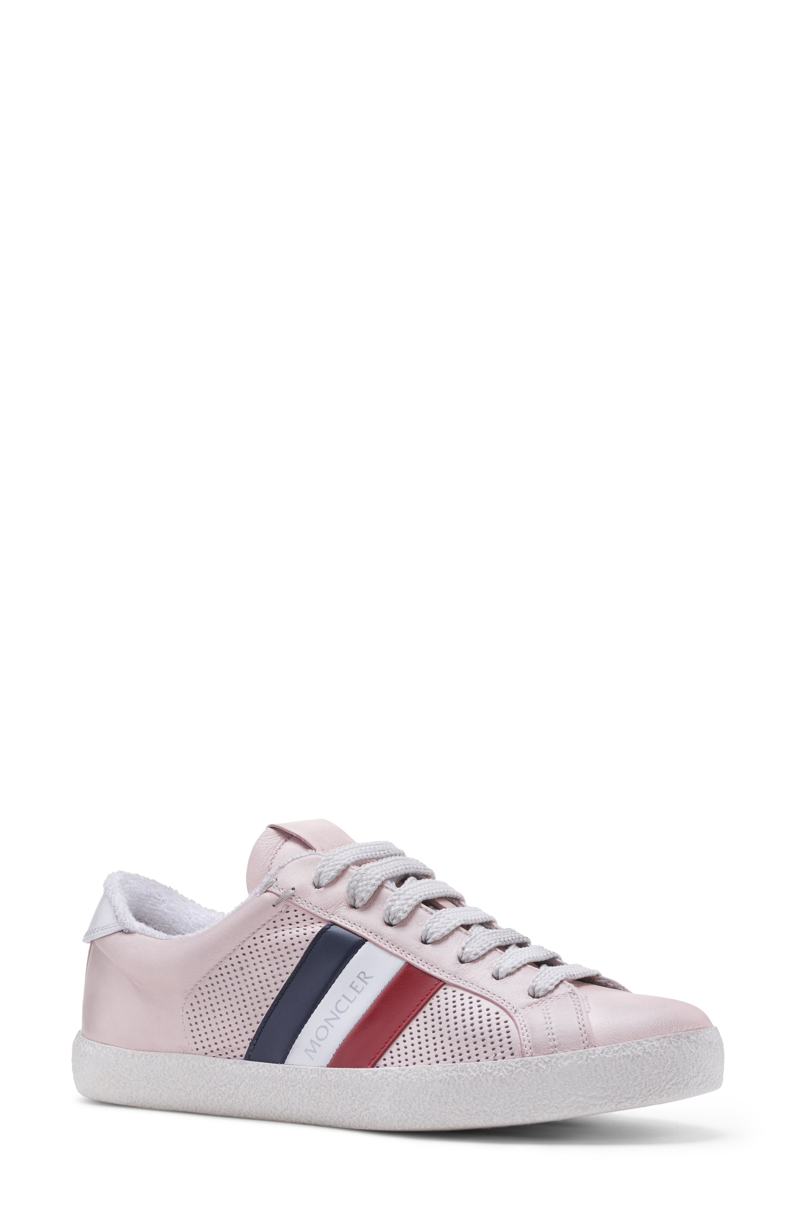 Tricolor logo stripes elevate the look of a low-top sneaker fashioned from smooth leather and embellished with sporty perforations. Style Name: Moncler Ryegrass Sneaker (Women). Style Number: 5971659. Available in stores.
