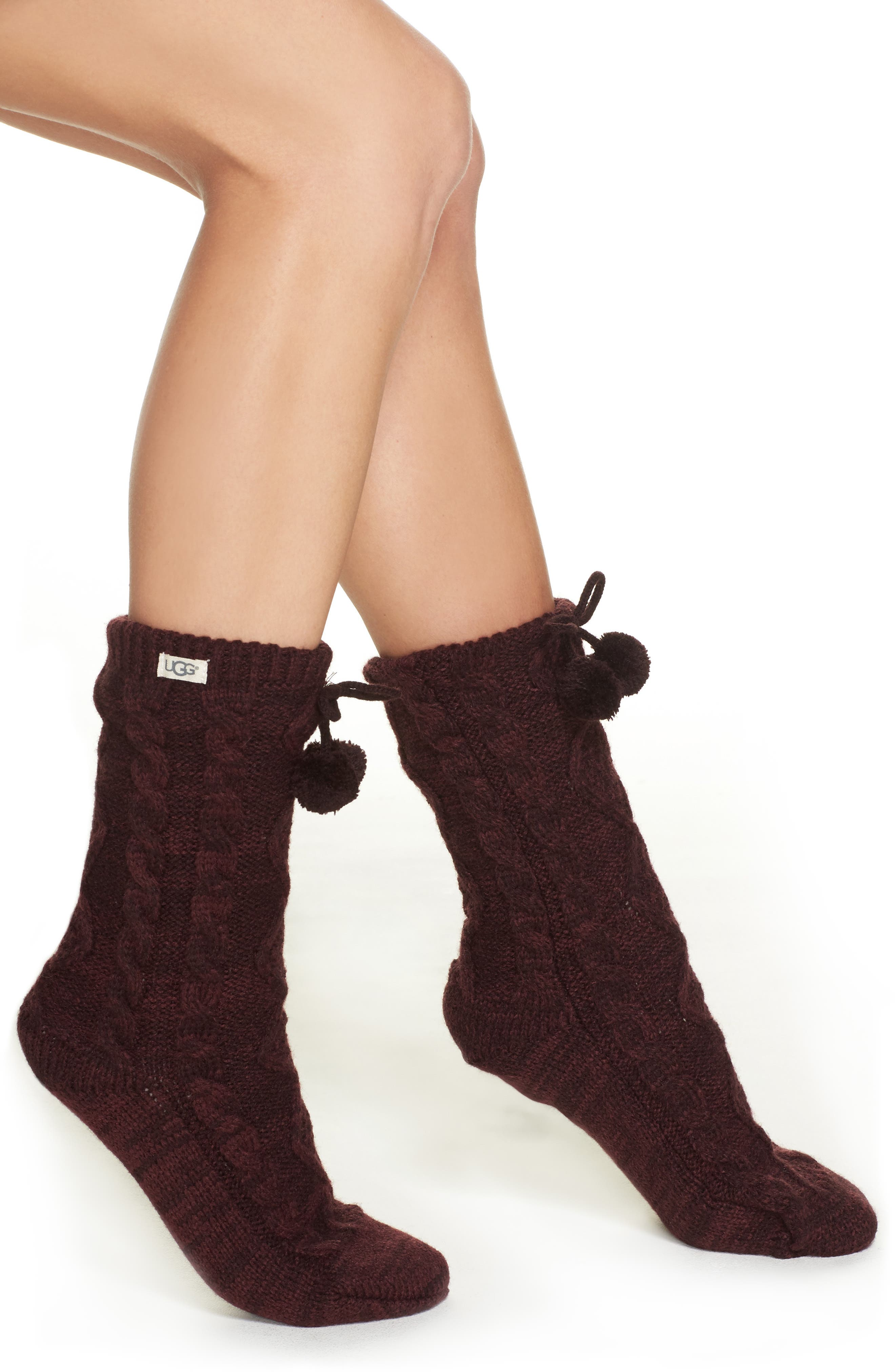 Chunky cable-knit yarn textures the exterior of these cozy crew socks enhanced by fuzzy pompom ties and plush fleece lining. Style Name: UGG Pompom Fleece Lined Socks. Style Number: 5207947 4. Available in stores.