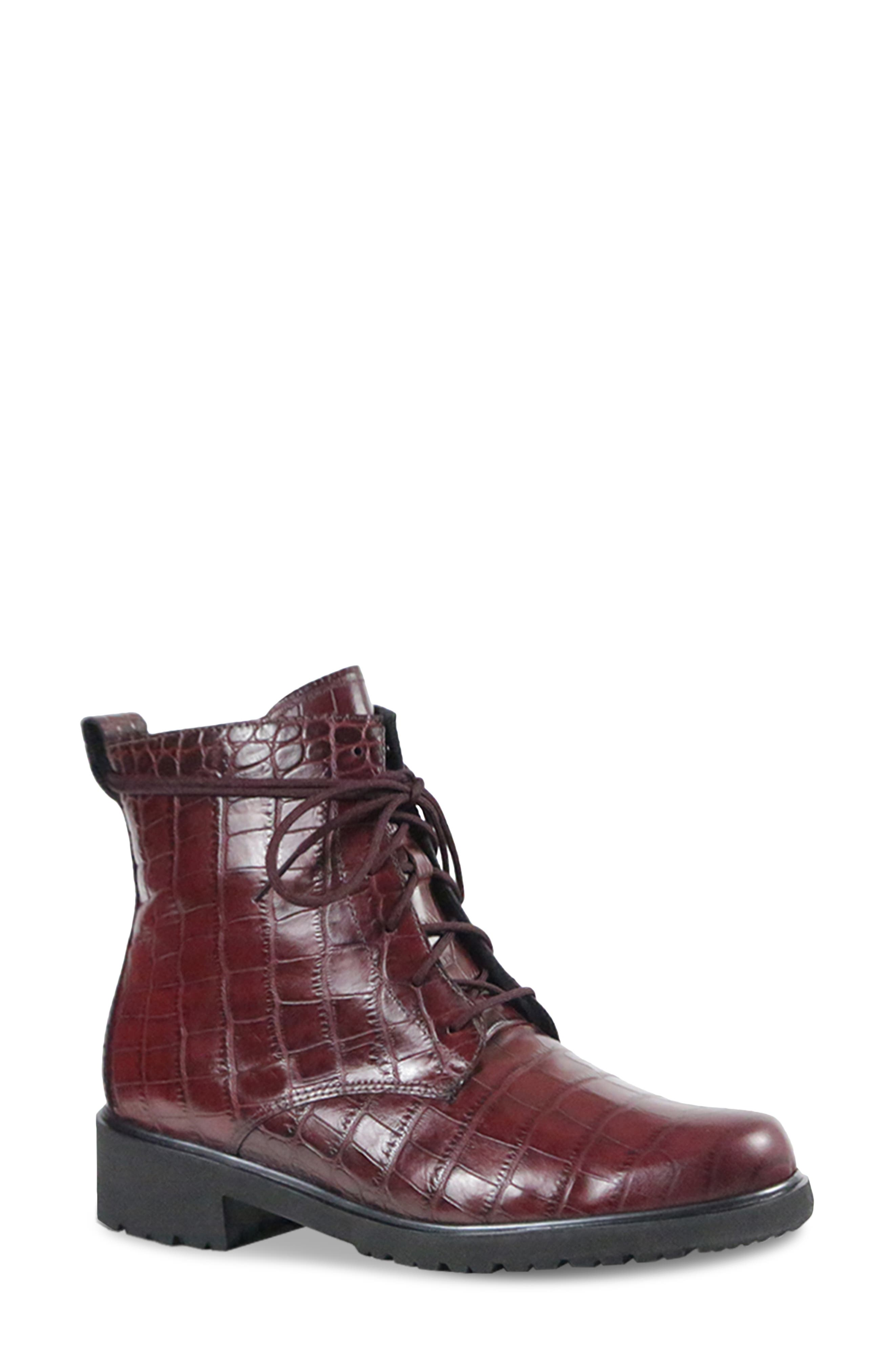 Svelte laces weave up the front and tie at the top of a streamlined bootie with a menswear-inspired Victorian profile grounded by a traction-enhancing sole. Style Name: Munro Finley Bootie (Women). Style Number: 6093592. Available in stores.