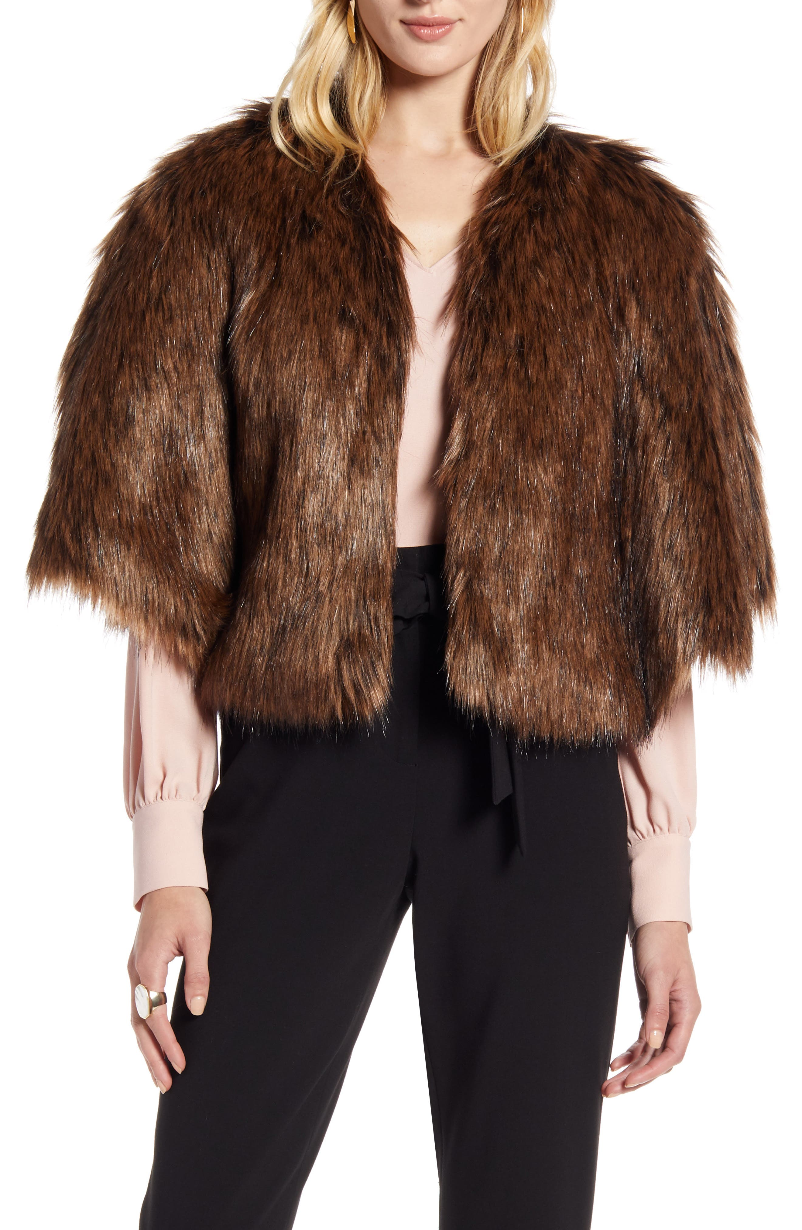 Perfect for topping off party looks or adding a plush touch to casual outfits, this faux-fur capelet is sure to be a go-to all season long. Style Name: Halogen Faux Fur Capelet. Style Number: 5861594. Available in stores.
