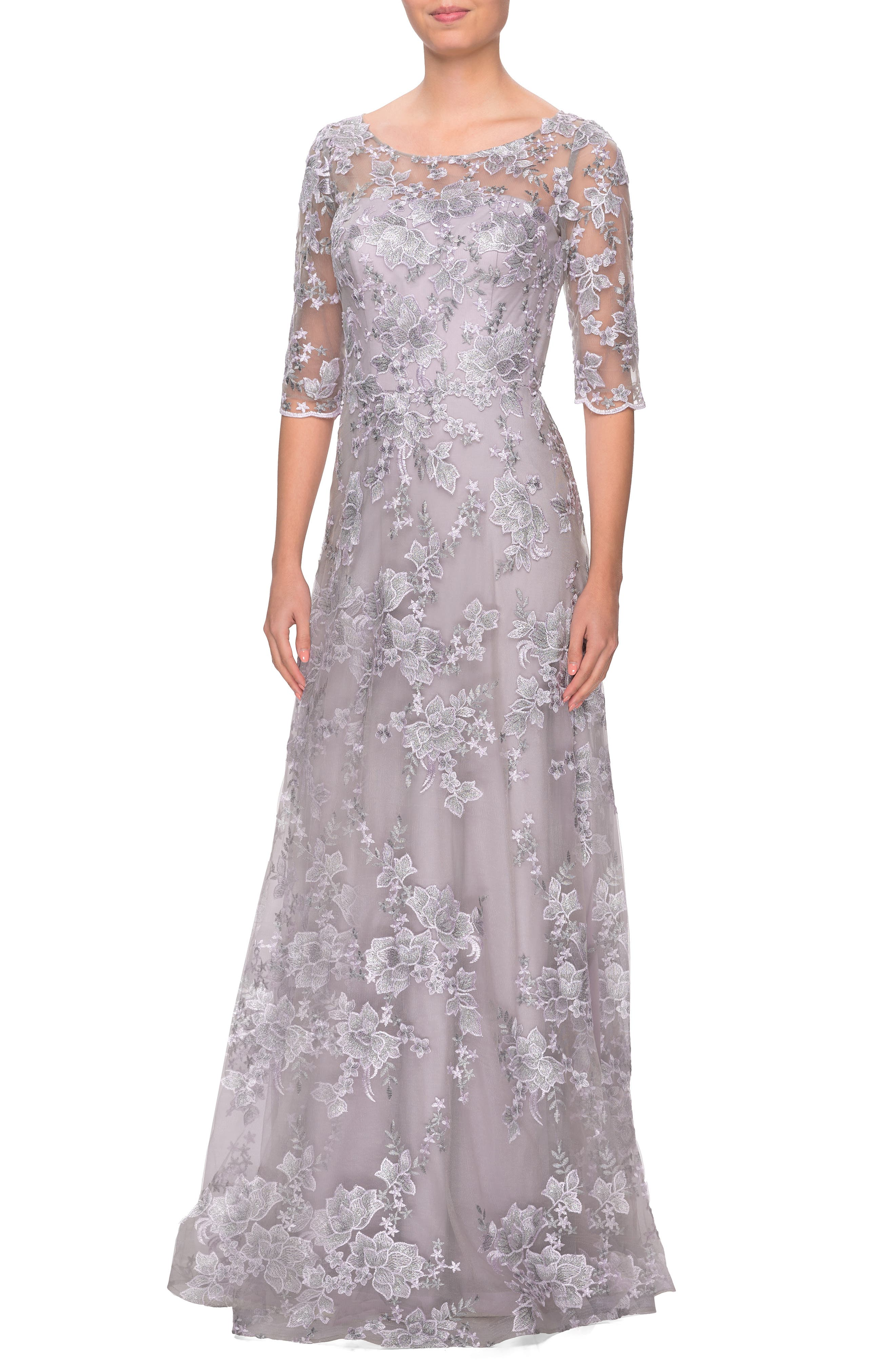 Let them see your sparkle before you ever say a word in this gorgeous gown shimmering in lustrous lace left sheer at the yoke and sleeves for a dash of allure. Style Name: La Femme Shimmer Lace A-Line Gown. Style Number: 6010066. Available in stores.