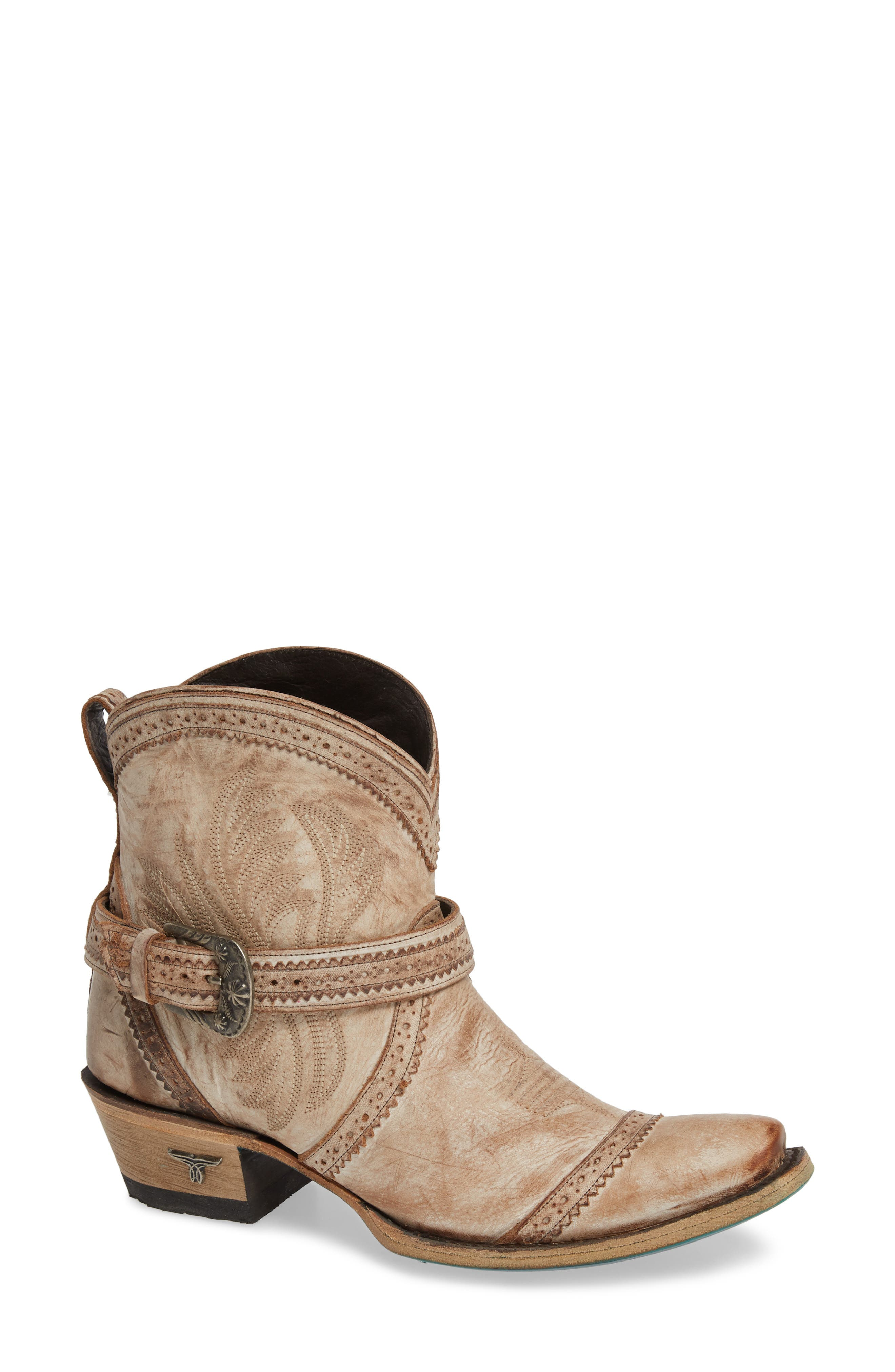 Handcrafted by skilled artisans in Leon, Mexico, this beautiful leather boot features menswear-inspired broguing and a Western buckle at the ankle strap. Style Name: Lane Boots Ballyhoo Bootie (Women). Style Number: 5727908. Available in stores.