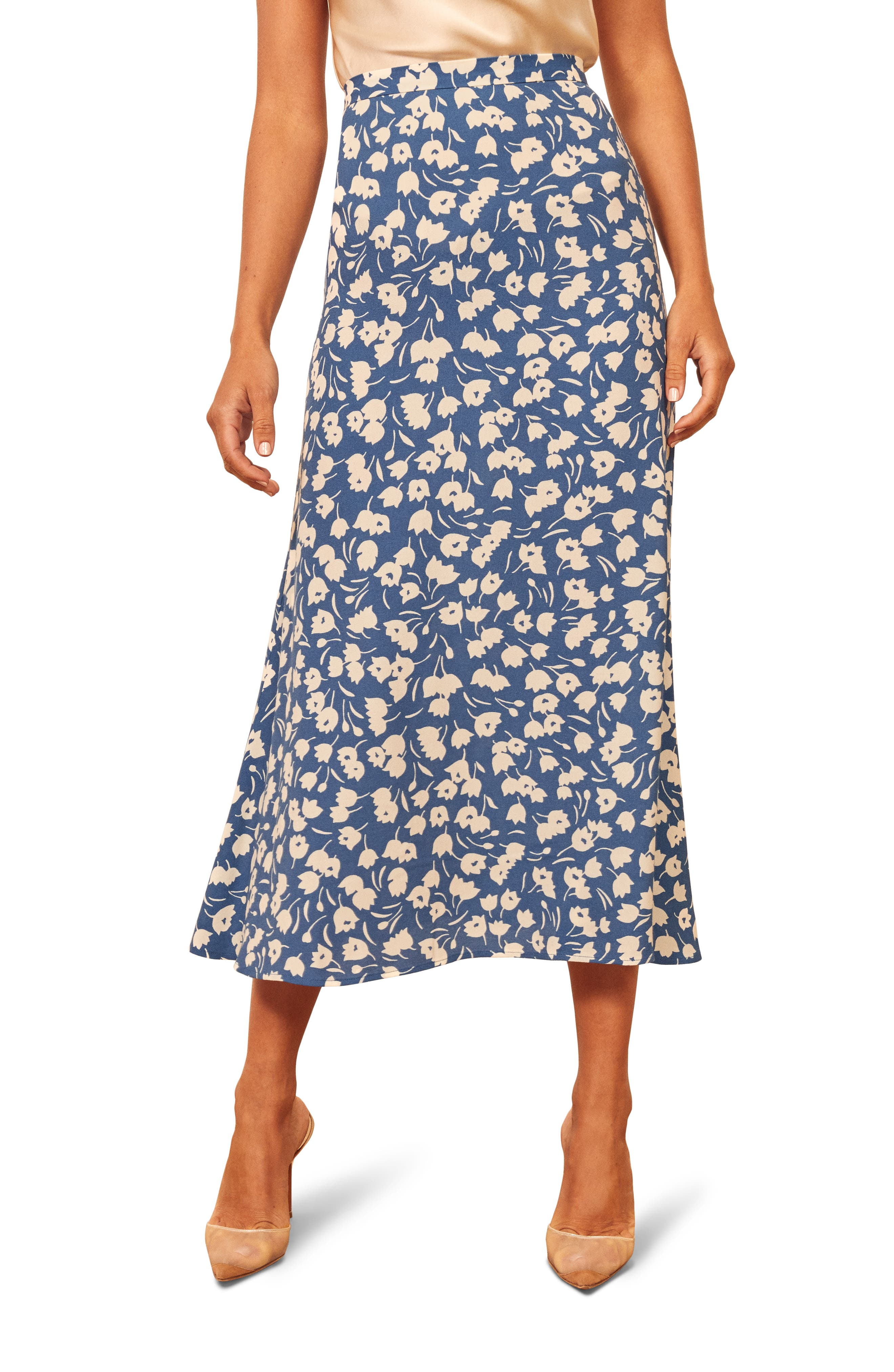 A choice of fresh prints enlivens a retro-inspired skirt cut with swingy flair and styled with a nipped-in, high waist for a flattering, ladylike look. Style Name: Reformation Bea Midi Skirt (Regular & Plus Size). Style Number: 5649715 1. Available in stores.