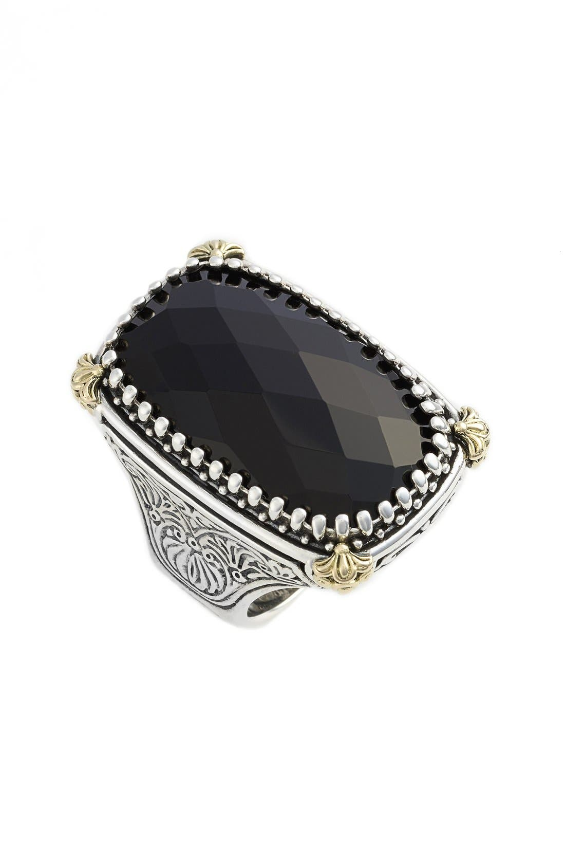 A faceted black onyx stone is framed by intricate 18-karat gold accents in a stunning sterling-silver ring inspired by the mystical Mediterranean night sky. Ornate etching embellishes each side of the band, ensuring the beautiful detail can be seen from all angles. Style Name: Konstantino \\\'Nykta\\\' Black Onyx Ring. Style Number: 5084317. Available in stores.