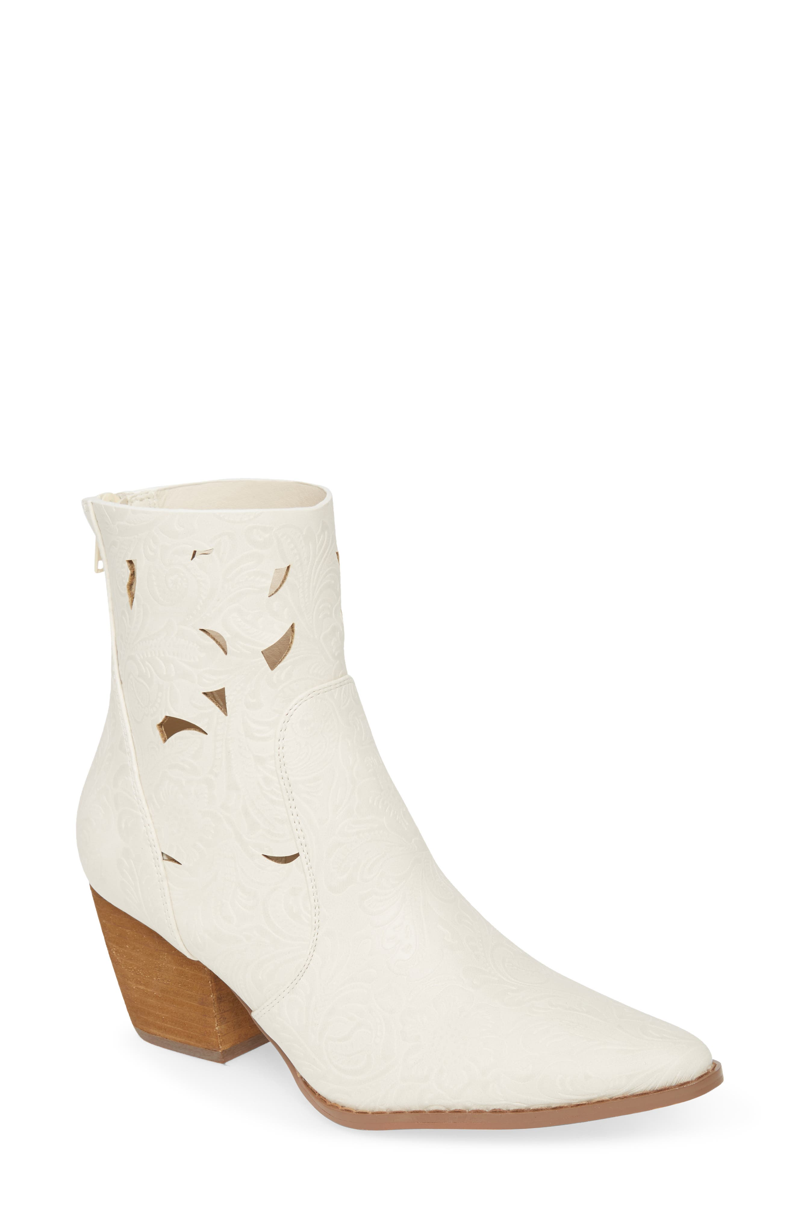 Laser-cut shapes act like flickers of light through the dense tooled garden of this pointy-toe Western-inspired bootie. Style Name: Coconuts By Matisse Acacia Laser Cut Bootie (Women). Style Number: 5951685. Available in stores.
