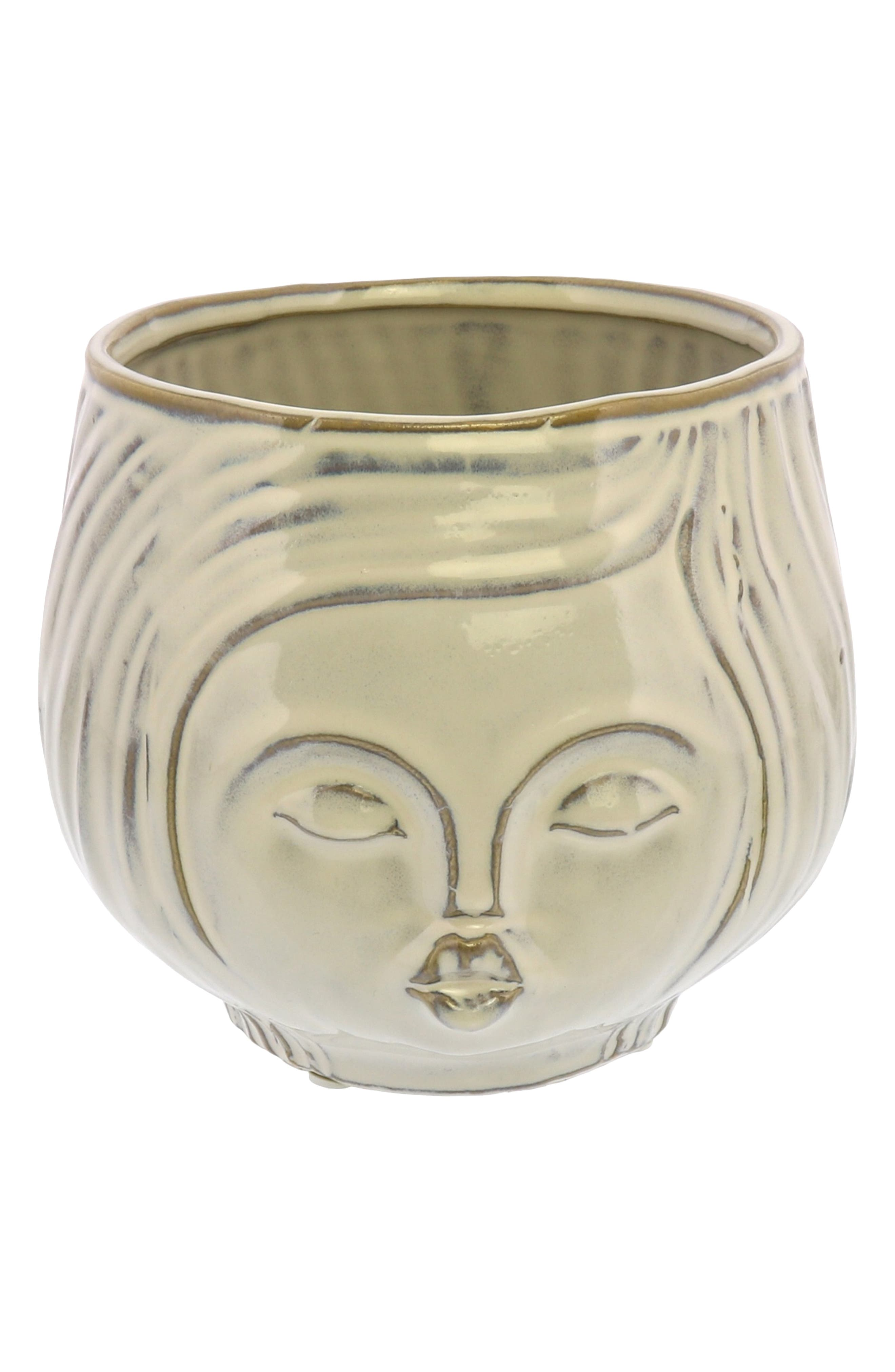 Your favorite succulents or fresh blooms will become a fun and funky hairdo for this gussied-up face pot with a creamy white glaze. Style Name: Homart Pucker Up Ceramic Vase. Style Number: 6123283. Available in stores.