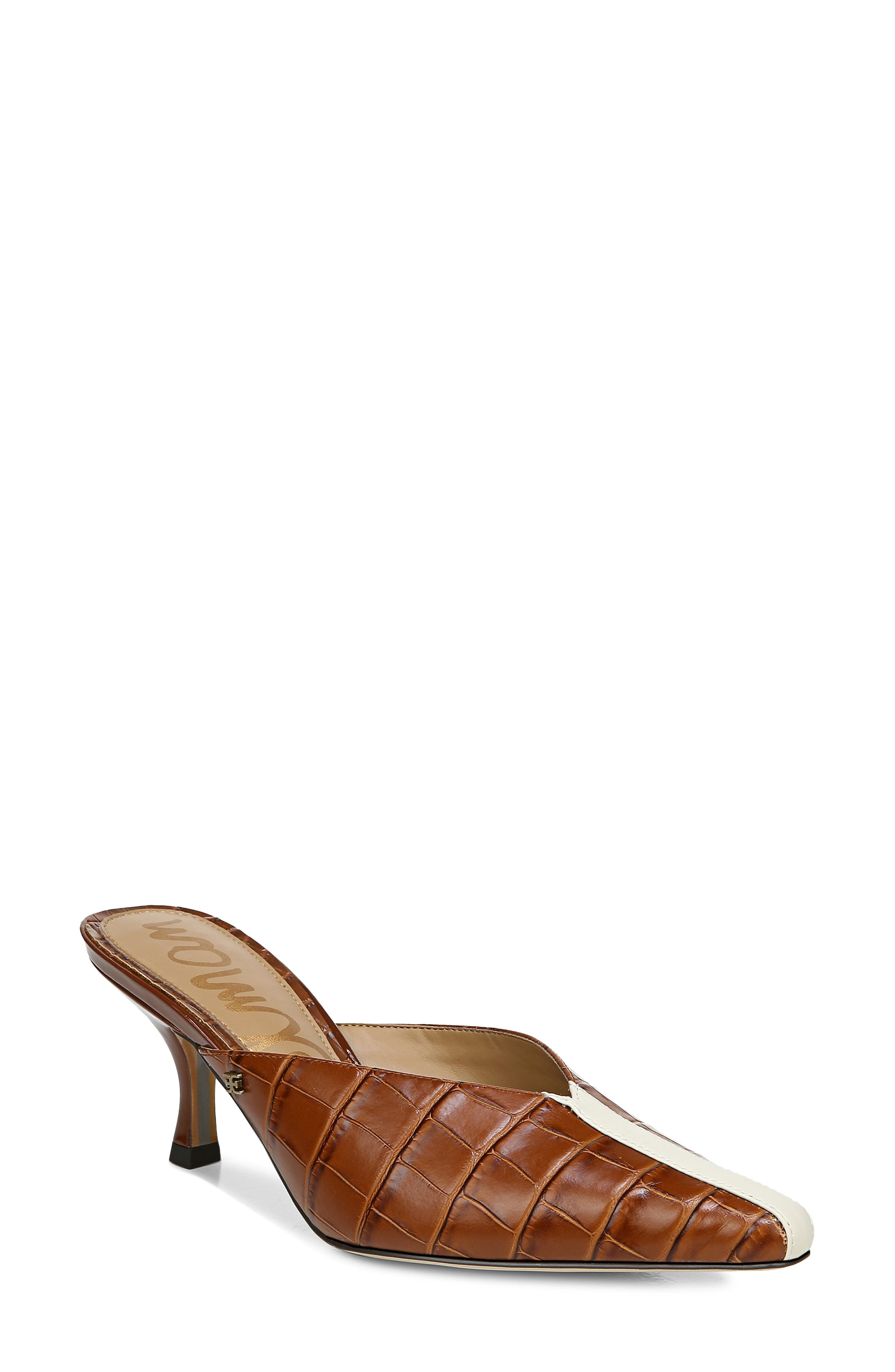 Contrast stitching runs up the pointy toe and lends a sophisticated racer touch to this fierce mule set on a low, sculpted heel. Style Name: Sam Edelman Tev Mule (Women). Style Number: 6065317. Available in stores.