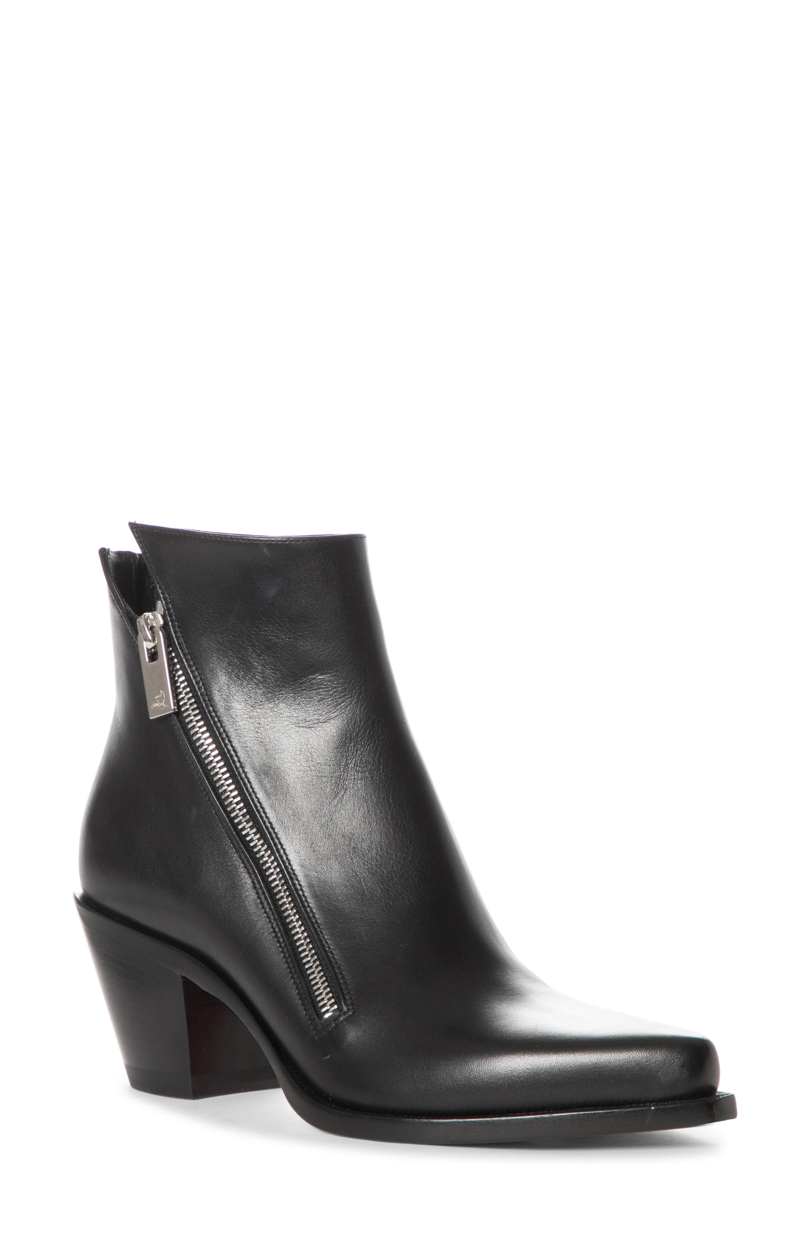 The blunted toe and angled heel are inspired by Western style, but this sleek leather bootie goes to the city with a sharply notched topline and an exposed zip. Style Name: Christian Louboutin Santia Zip Bootie (Women). Style Number: 6046871. Available in stores.
