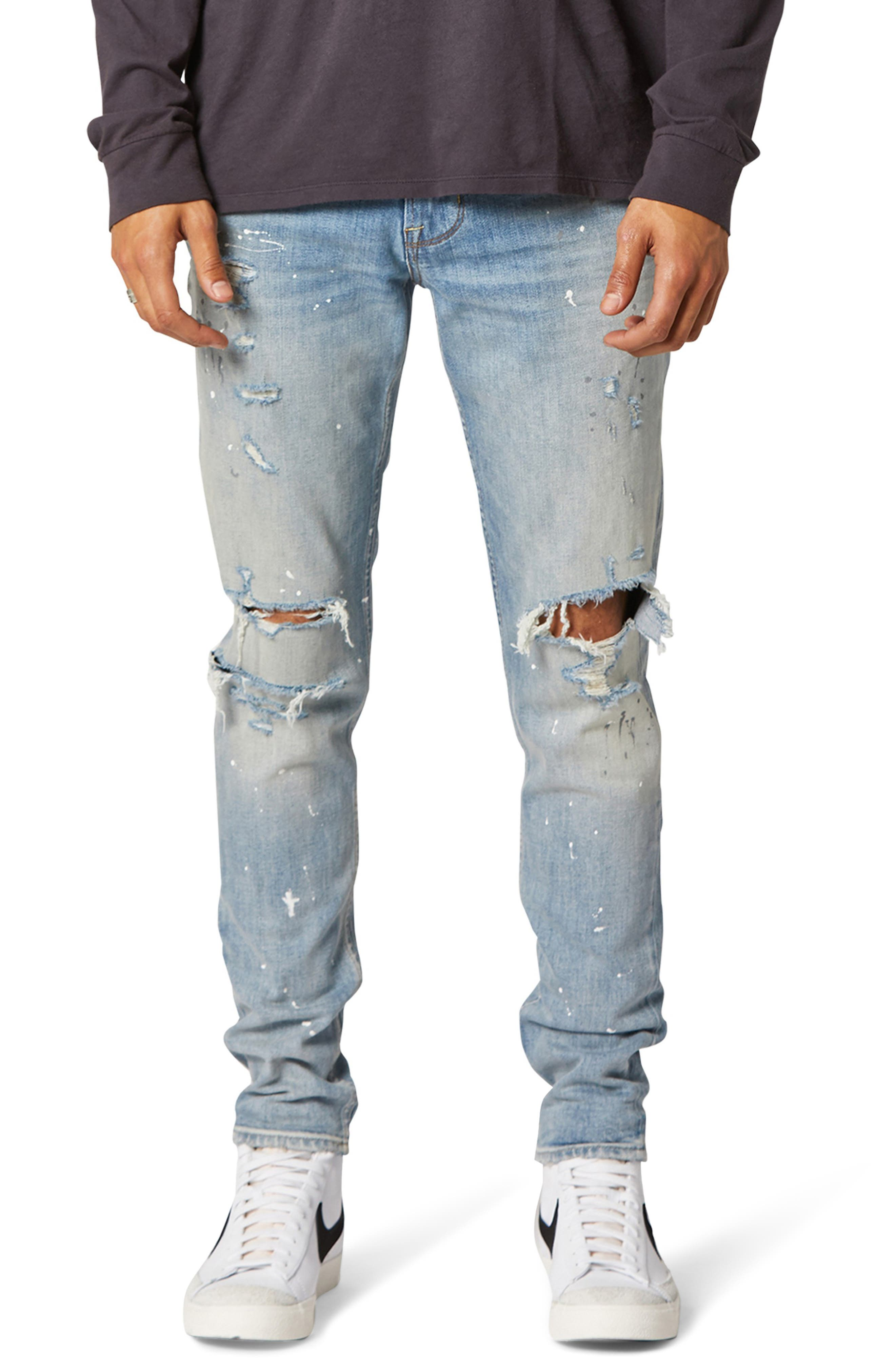 Rips, shreds and the evidence of sloppy painting bring a lot of history to skinny-cut jeans that are totally faded and authentically grungy. Style Name: Hudson Jeans Zack Ripped Skinny Fit Jeans (Mural). Style Number: 6099070. Available in stores.