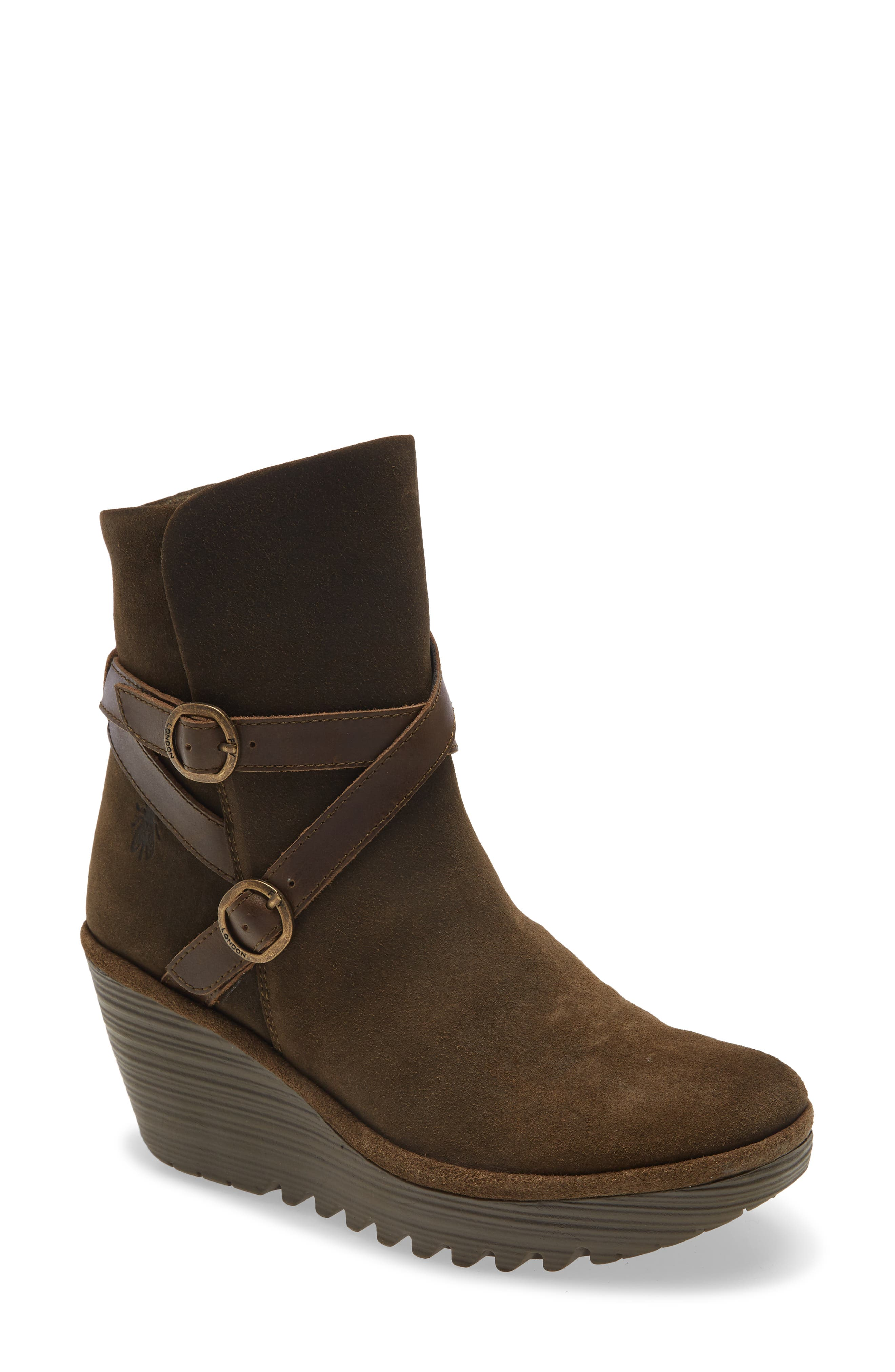 Slim straps and tiny buckles wrap around the ankle and bring subtle moto edge to a chic boot lofted by a textured, walkable wedge. Style Name: Fly London Yemo Buckle Wedge Boot (Women). Style Number: 6094336. Available in stores.