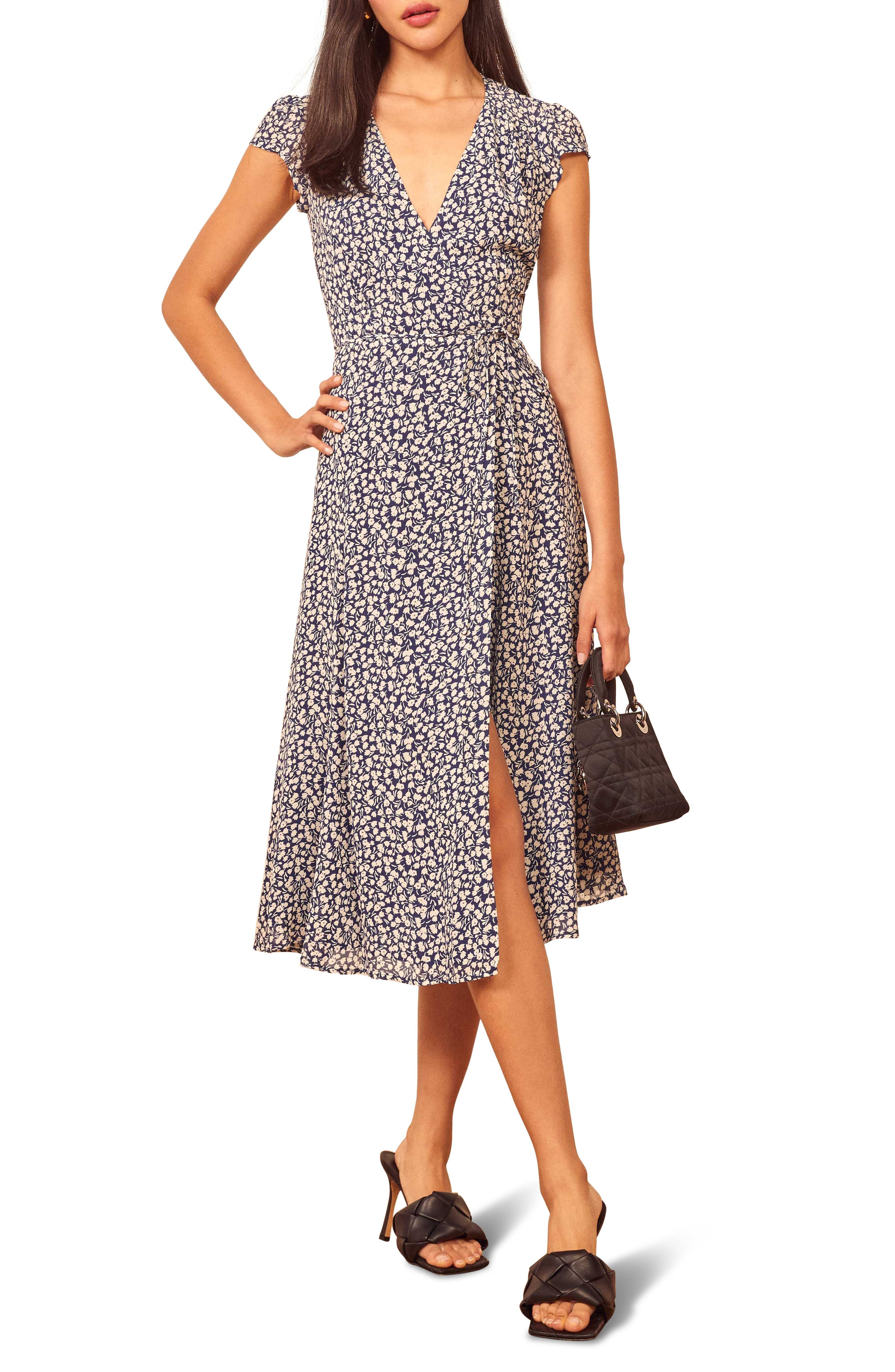 Ladylike for the bold, this fluttery georgette wrap dress shows major leg while retaining a little innocence with soft gathered detail at the bodice. Style Name: Reformation Carina Midi Wrap Dress (Regular & Plus Size) (Nordstrom Exclusive). Style Number: 5649734. Available in stores.