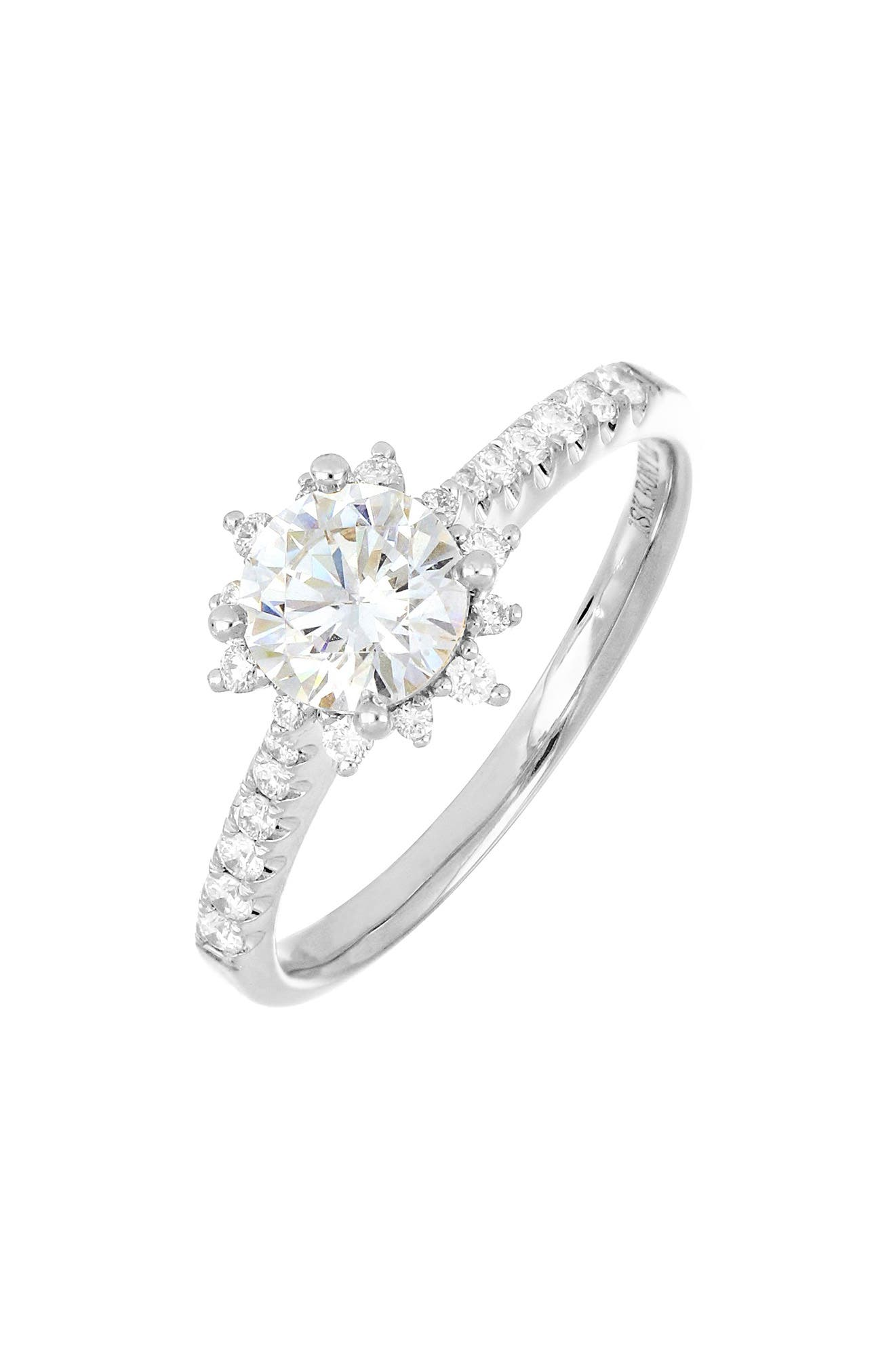 Pave-set diamonds-24 in all-add brilliant shine to the band and solitaire setting of a striking 18-karat-gold ring topped by a round cubic zirconia. Wear it as is, or you can buy and add the gem of your choice in place of the cubic zirconia after the proposal. Style Name: Bony Levy Pave Diamond & Cubic Zirconia Vintage Solitaire Engagement Ring (Nordstrom Exclusive). Style Number: 6091370. Available in stores.